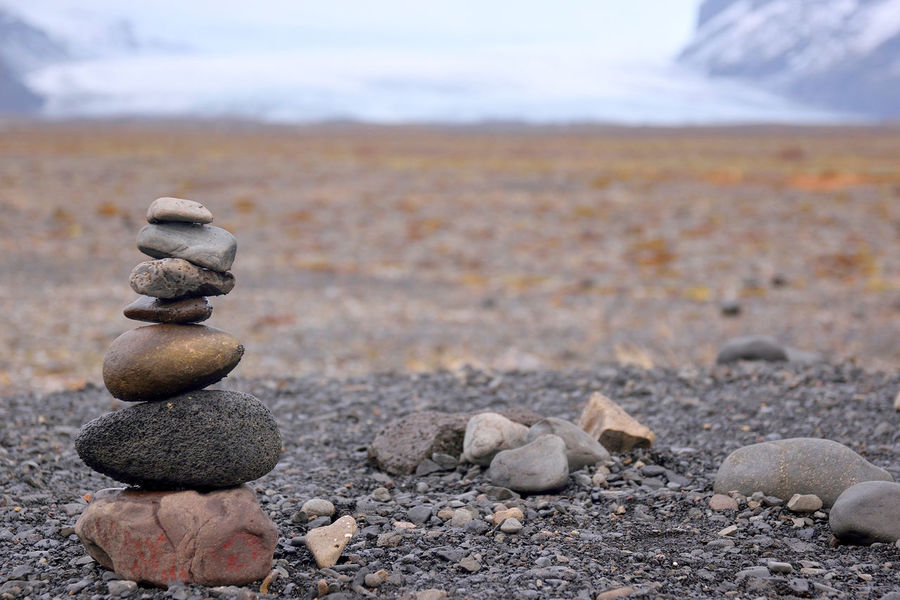 Iceland Beach Beauty In Nature Cairn Close-up Day Focus On Foreground Glaciers Landscape Low Depth Of Field Nature Outdoors Pebble Scenics Sea Sky Stack Stack Of Stones Stone - Object Tranquility Waypoints EyeEm Ready   EyeEmNewHere Shades Of Winter