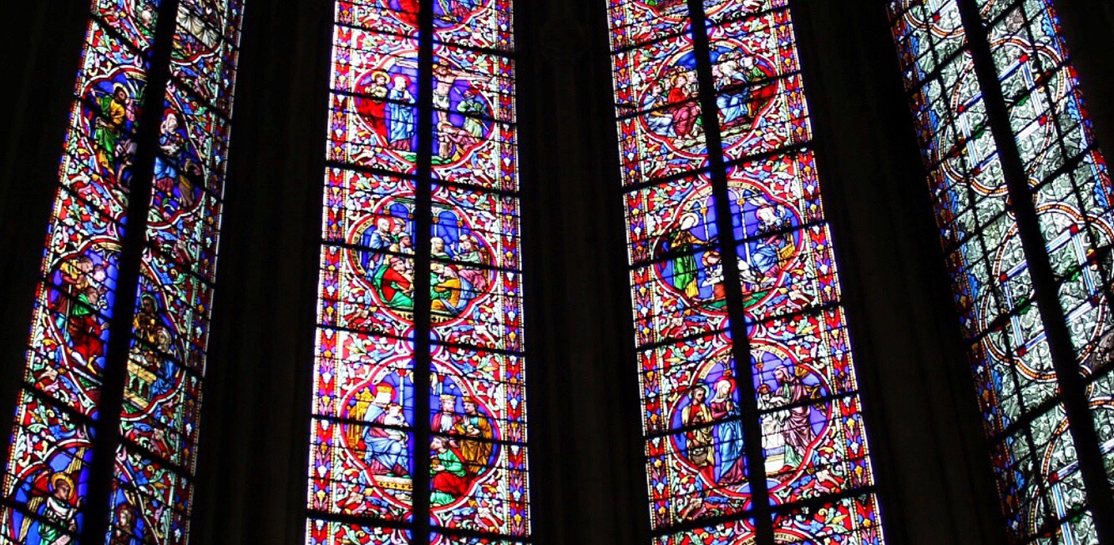stained glass, indoors, pattern, low angle view, window, multi colored, no people, backgrounds, full frame, day, place of worship, close-up