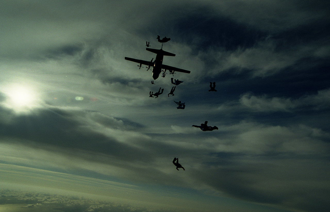 flying, sky, cloud - sky, mid-air, low angle view, airplane, silhouette, airshow, transportation, air vehicle, speed, outdoors, no people, teamwork, day, togetherness, fighter plane, military airplane, nature, vapor trail