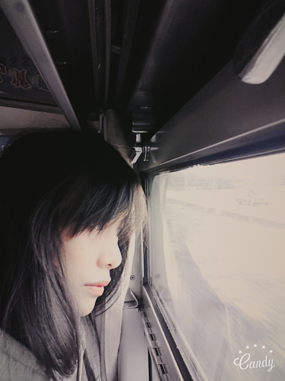 vehicle interior, transportation, mode of transport, travel, real people, journey, one person, vehicle seat, land vehicle, black hair, car interior, public transportation, lifestyles, young adult, window, train - vehicle, young women, air vehicle, day, airplane, sitting, indoors, close-up