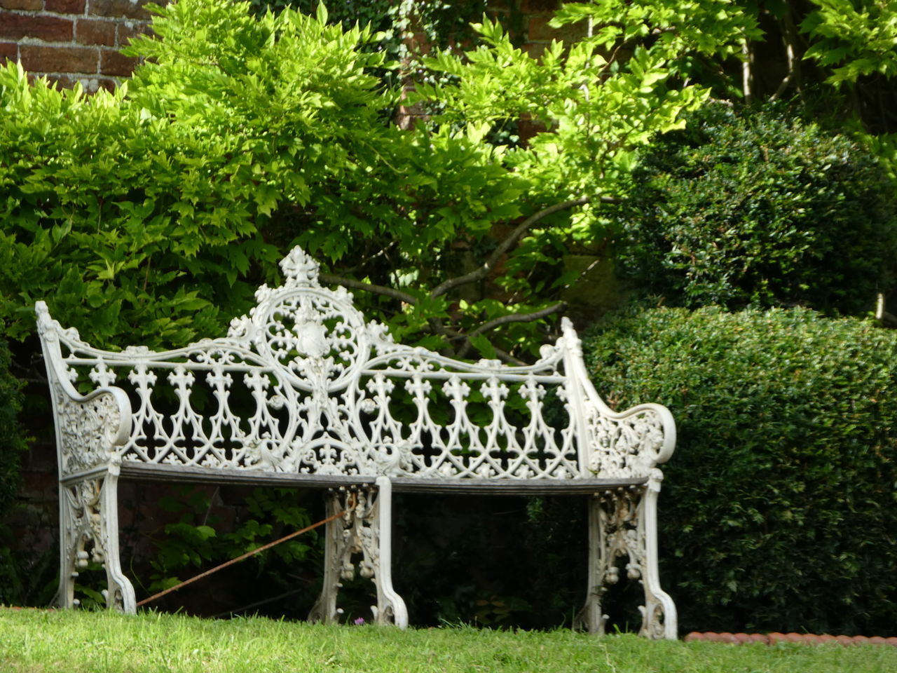 Beautiful, peaceful, solitude. Bench Seat Wrought Iron Design Iron White Lush Foliage Green Color Formal Garden Lawn Outdoors Park Tranquility Garden Grass Green Plant Sunlight Place To Relax❤ Nature Peaceful Tranquil Scene