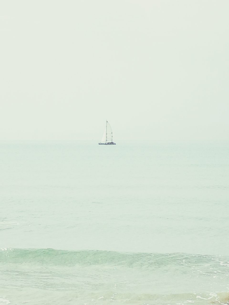 sea, horizon over water, water, scenics, beauty in nature, nature, tranquility, outdoors, waterfront, day, tranquil scene, no people, clear sky, sailboat, sky, nautical vessel, sailing