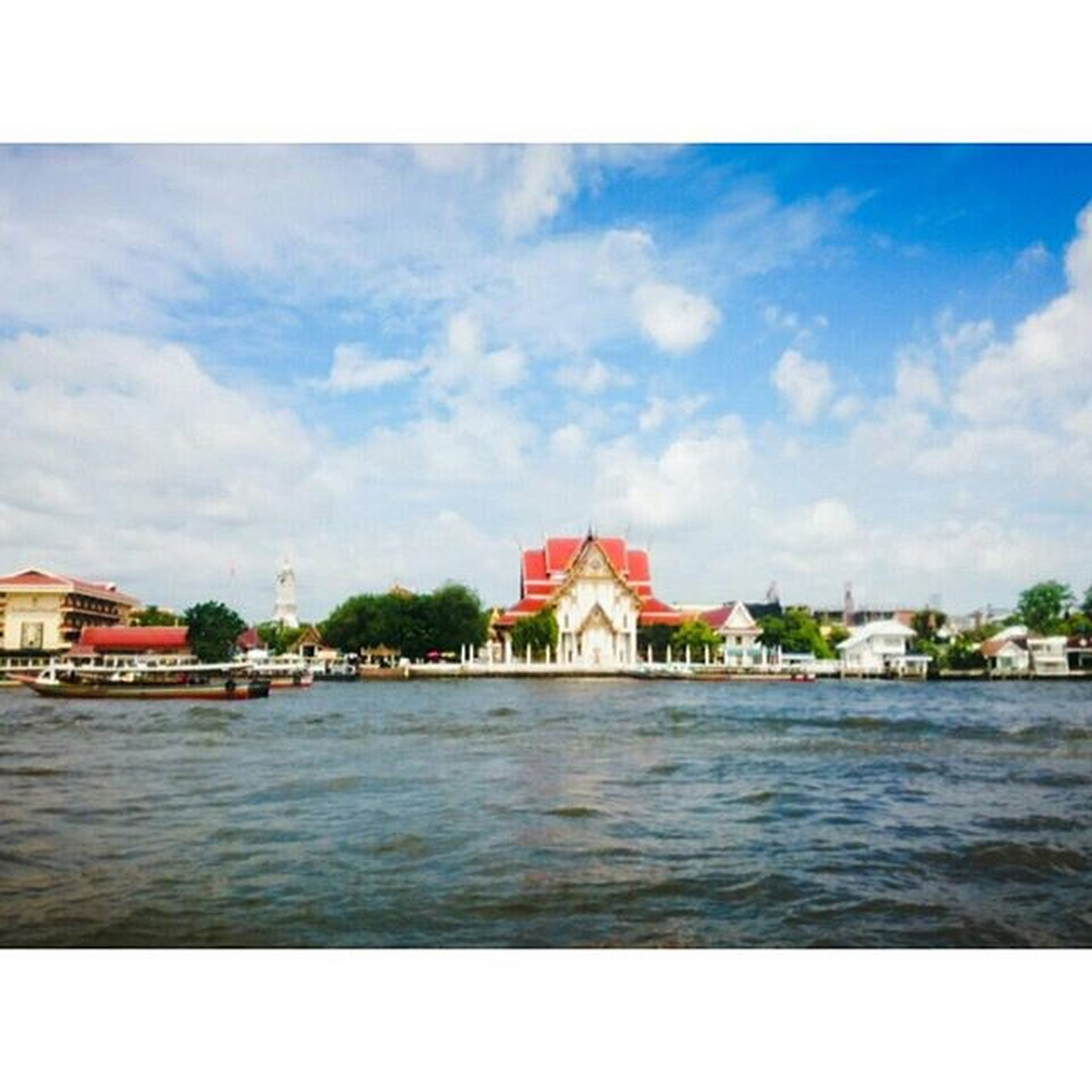 architecture, built structure, building exterior, water, sky, waterfront, cloud - sky, river, house, cloud, transfer print, auto post production filter, rippled, residential structure, day, place of worship, outdoors, religion, lake, no people