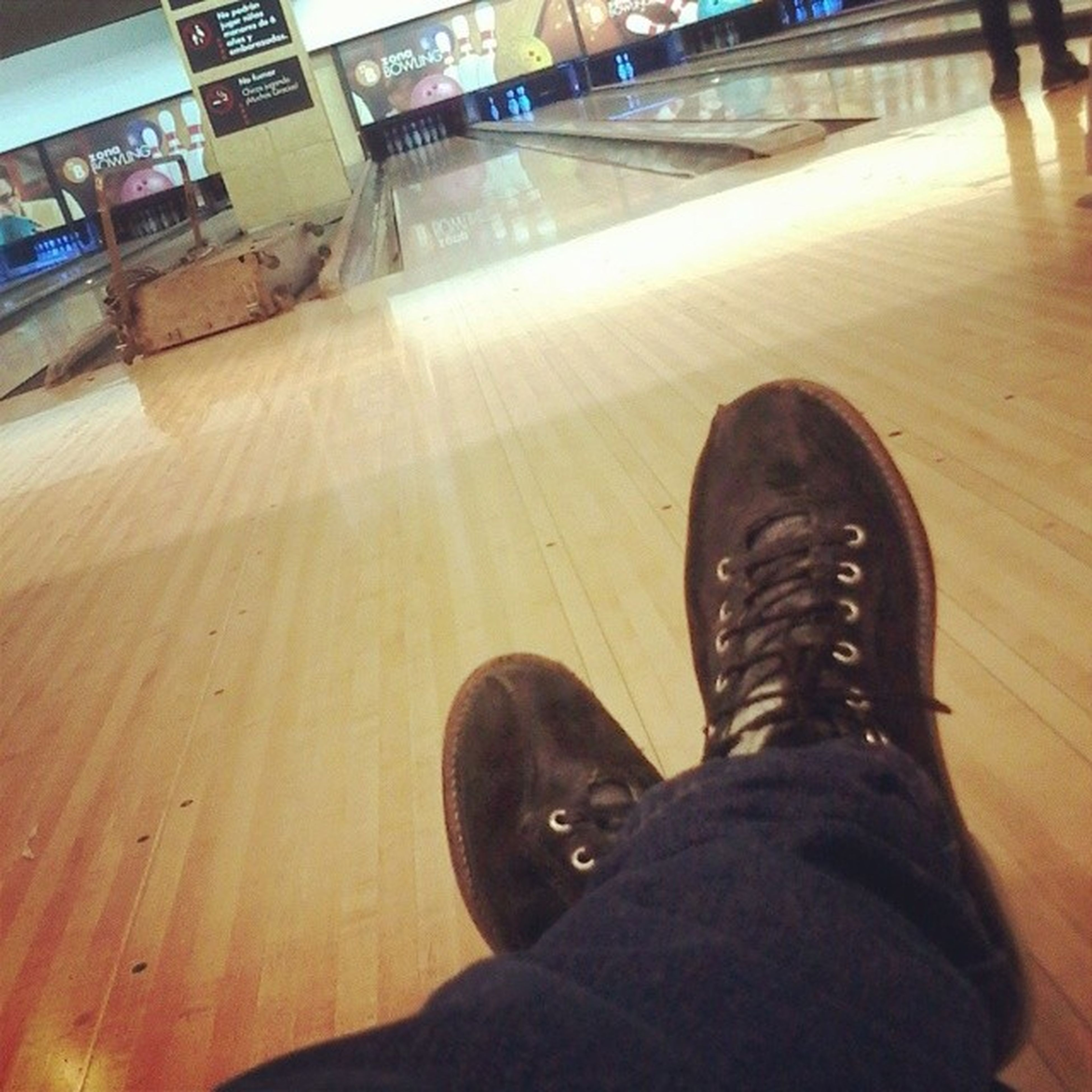 low section, indoors, person, personal perspective, shoe, lifestyles, men, high angle view, leisure activity, unrecognizable person, flooring, human foot, pets, sitting, black color, standing, floor