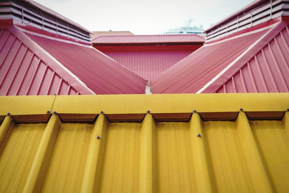 Shapes of Grenada Roof Architecture Building Exterior Built Structure House Yellow Outdoors Day Corrugated Iron No People Multi Colored Sky EyeEm Best Shots Open Edit Eye4photography  Fresh 3 Triangle Shape Architecture Building Architecture_collection Architectural Detail Minimalist Architecture Art Is Everywhere