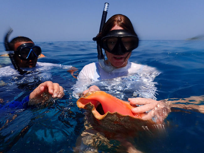Adventure Blue Conch Day Enjoyment Fun Leisure Activity Lifestyles Nature Outdoors Sea Sky Snorkeling Snorkeling Mask Sunlight Vacations Water Photojournalist Eyeem 2016 Photojournalist - 2016 EyeEm Awards People Of The Oceans Belize  Travel Photography Travel Travel Destinations Feel The Journey