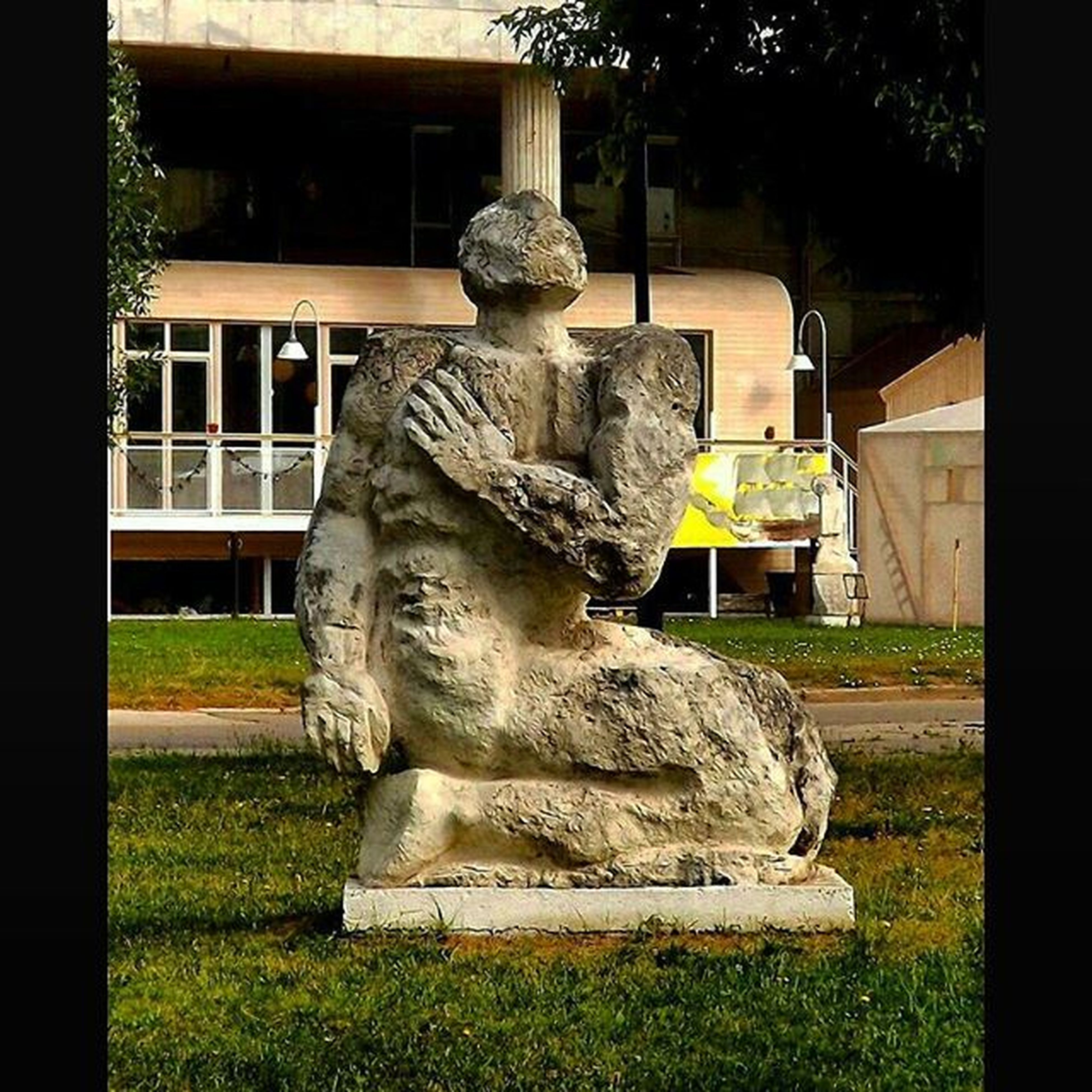 statue, sculpture, human representation, art, art and craft, creativity, built structure, carving - craft product, stone material, architecture, animal representation, grass, craft, tree, fountain, building exterior, buddha, park - man made space