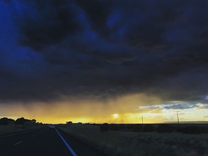 Even further down road due west, the sky got even darker as we found ourselves beneath the mayhem. We had not yet met the rain at this point, just the glow. Cowspringsaz Sunsetting Sunsetseries Dramatic Sky Bluesandyellows Car Point Of View Passenger Seat Photo Shoot Beauty In Nature Diminishing Perspective Majestic Into The West Iphone7plusphoto IPhone Photography Sunsetphotography Myownphotography EyeEm Viewing Eyesee Autumn 2016