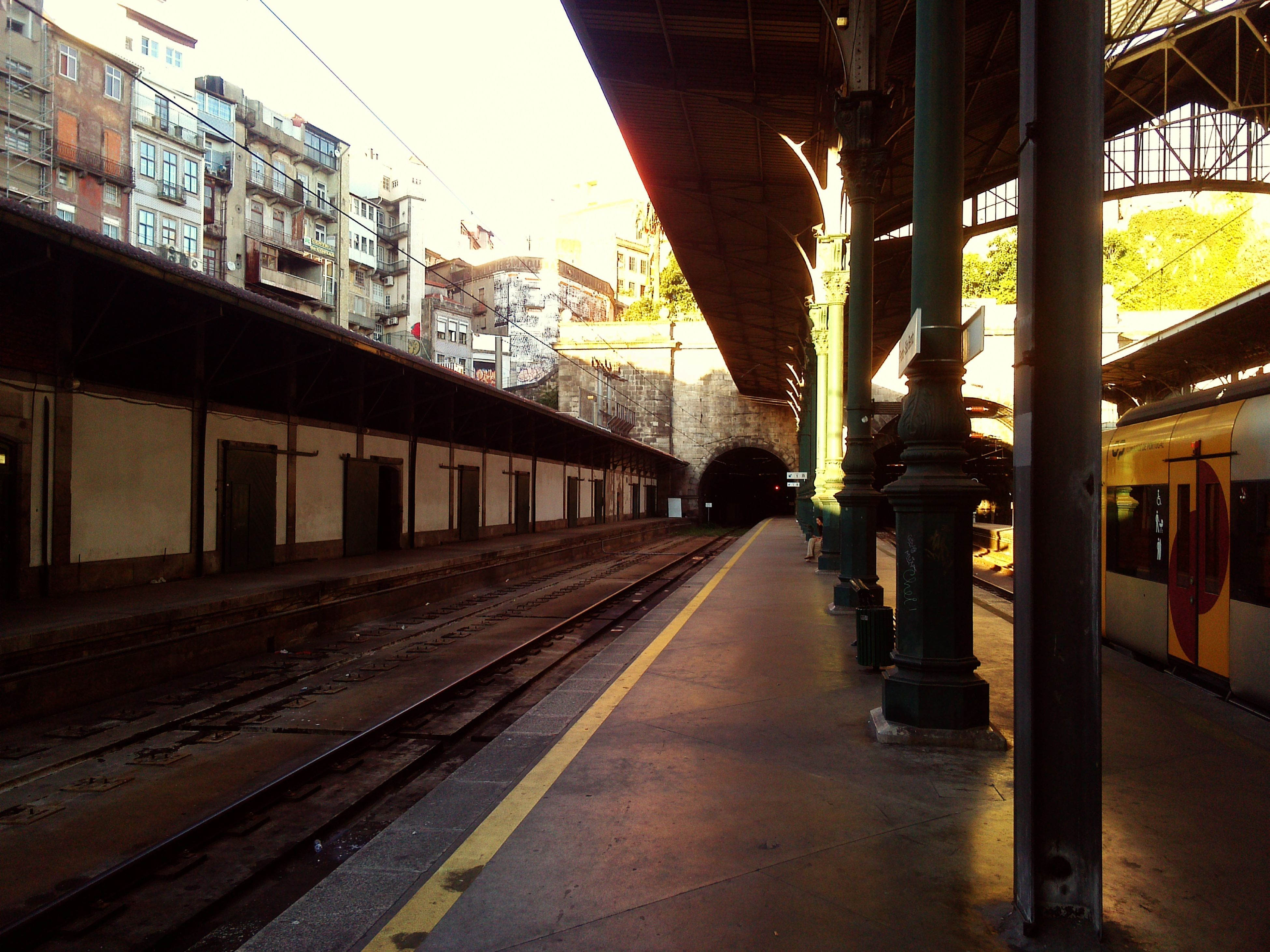 architecture, built structure, the way forward, railroad track, transportation, building exterior, diminishing perspective, vanishing point, rail transportation, city, public transportation, empty, long, railroad station platform, sky, railroad station, incidental people, outdoors, connection, no people