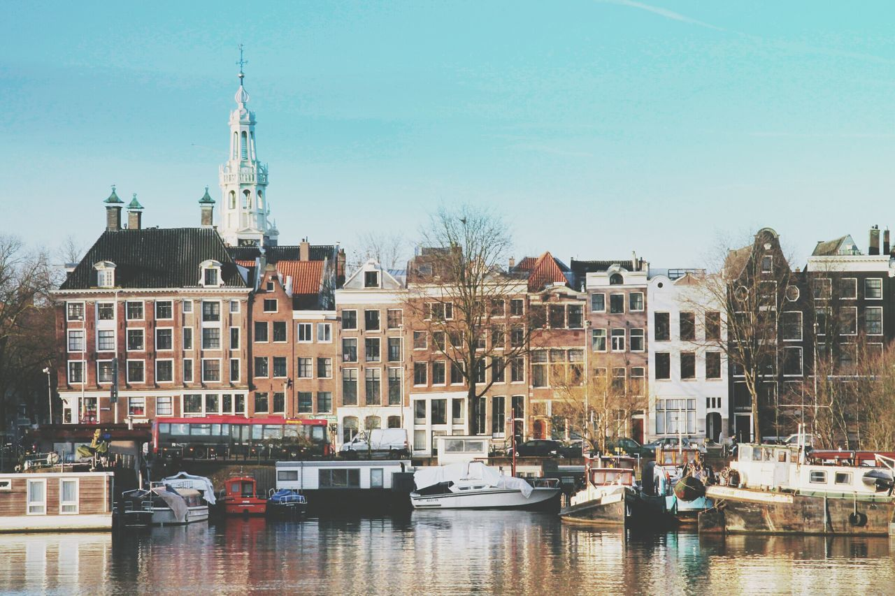 I am sterdam ! City Nautical Vessel Travel Destinations Transportation Building Exterior River Water Cityscape Tree Outdoors Bridge - Man Made Structure Sky Day No People Architecture Tourboat Clock Face Amsterdam Amsterdam Canal Amsterdamcity Amsterdam.nl Iamsterdam