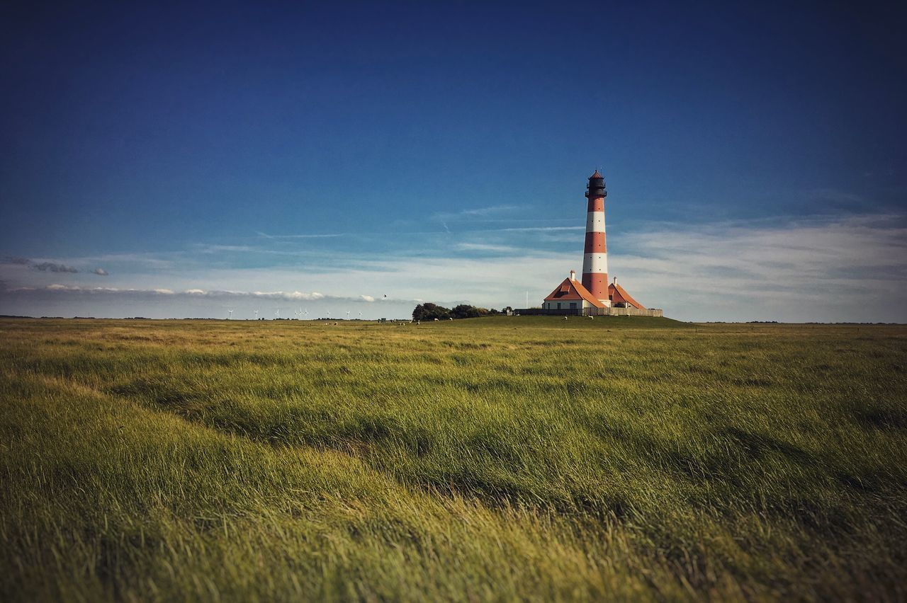Lighthouse in Westerhever, Germany. Field Grass Architecture Nature Landscape Sky Tranquility Built Structure Outdoors No People Tranquil Scene Beauty In Nature Building Exterior Scenics Lighthouse Day Westerhever Westerhever Leuchtturm Westerhever Lighthouse Sommergefühle Sommergefühl