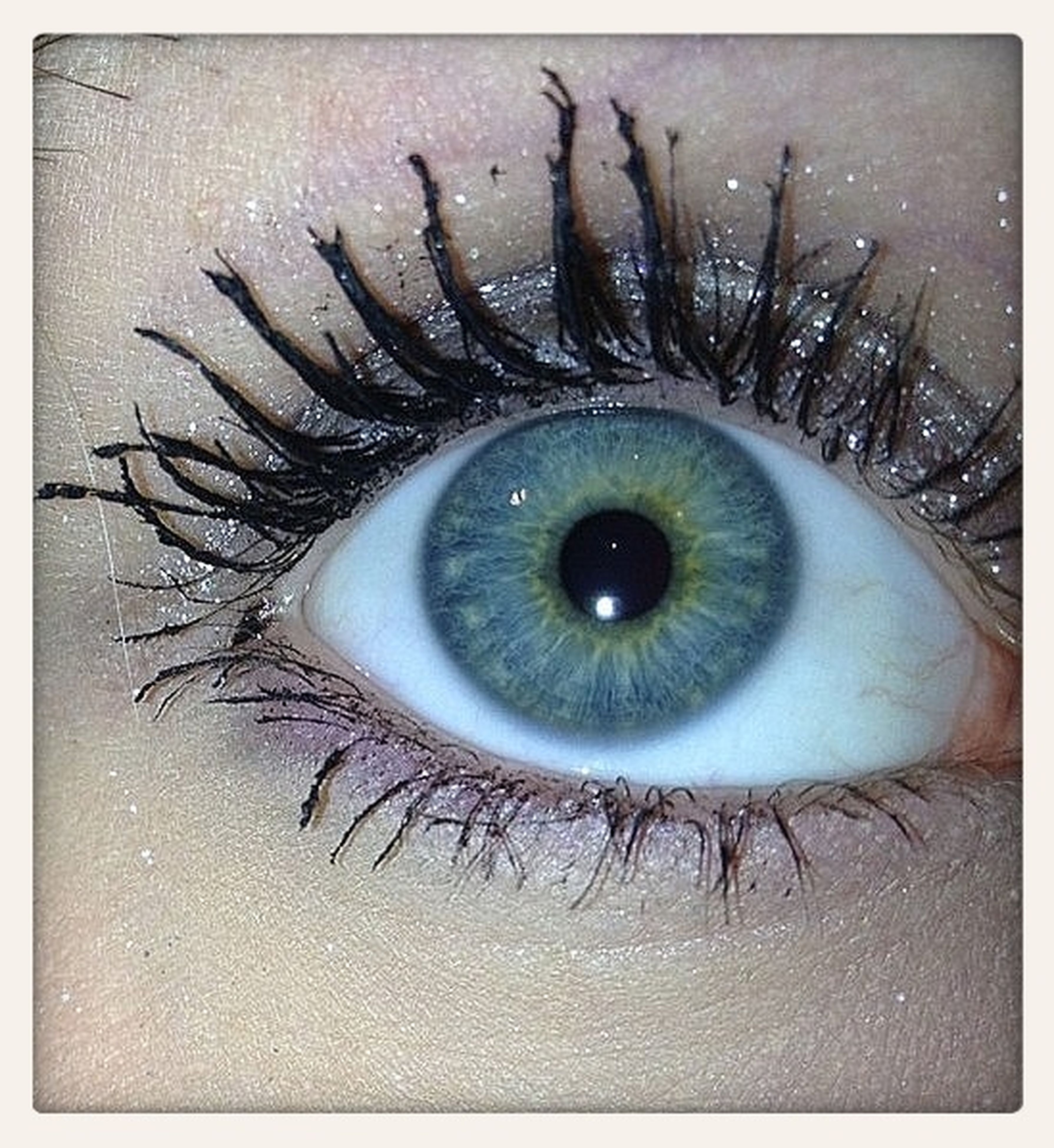 transfer print, auto post production filter, close-up, human eye, sensory perception, eyelash, indoors, eyesight, circle, extreme close-up, single object, high angle view, directly above, portrait, looking at camera, part of, one person, full frame, eyeball