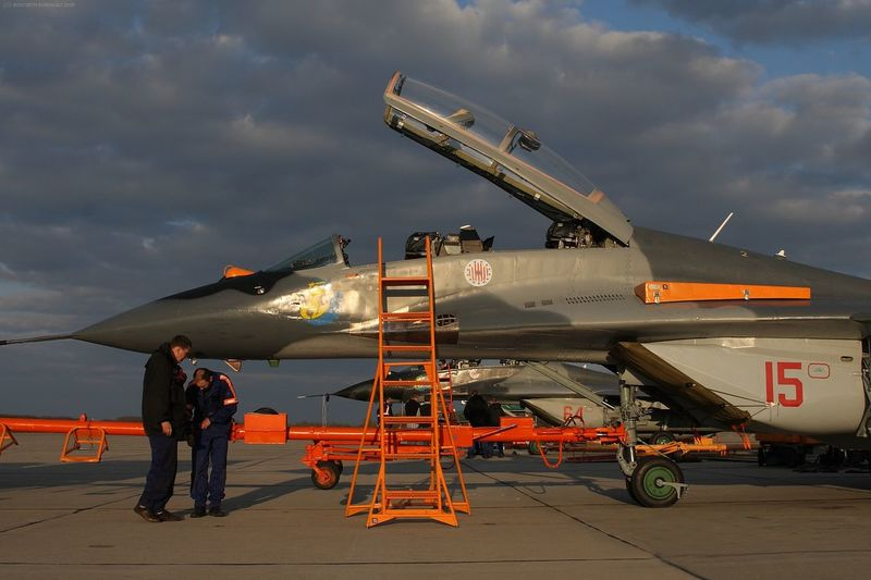 Aerospace Industry Air Base Air Force Air Vehicle Aircraft Airplane Airport Runway Cloud - Sky Cockpit Day Industry Maintainance Mig-29 Mikoyan I Gurevich Mikoyan Mig-29 Only Men Orange Outdoors People Plane Polish Sky Teamwork Two People