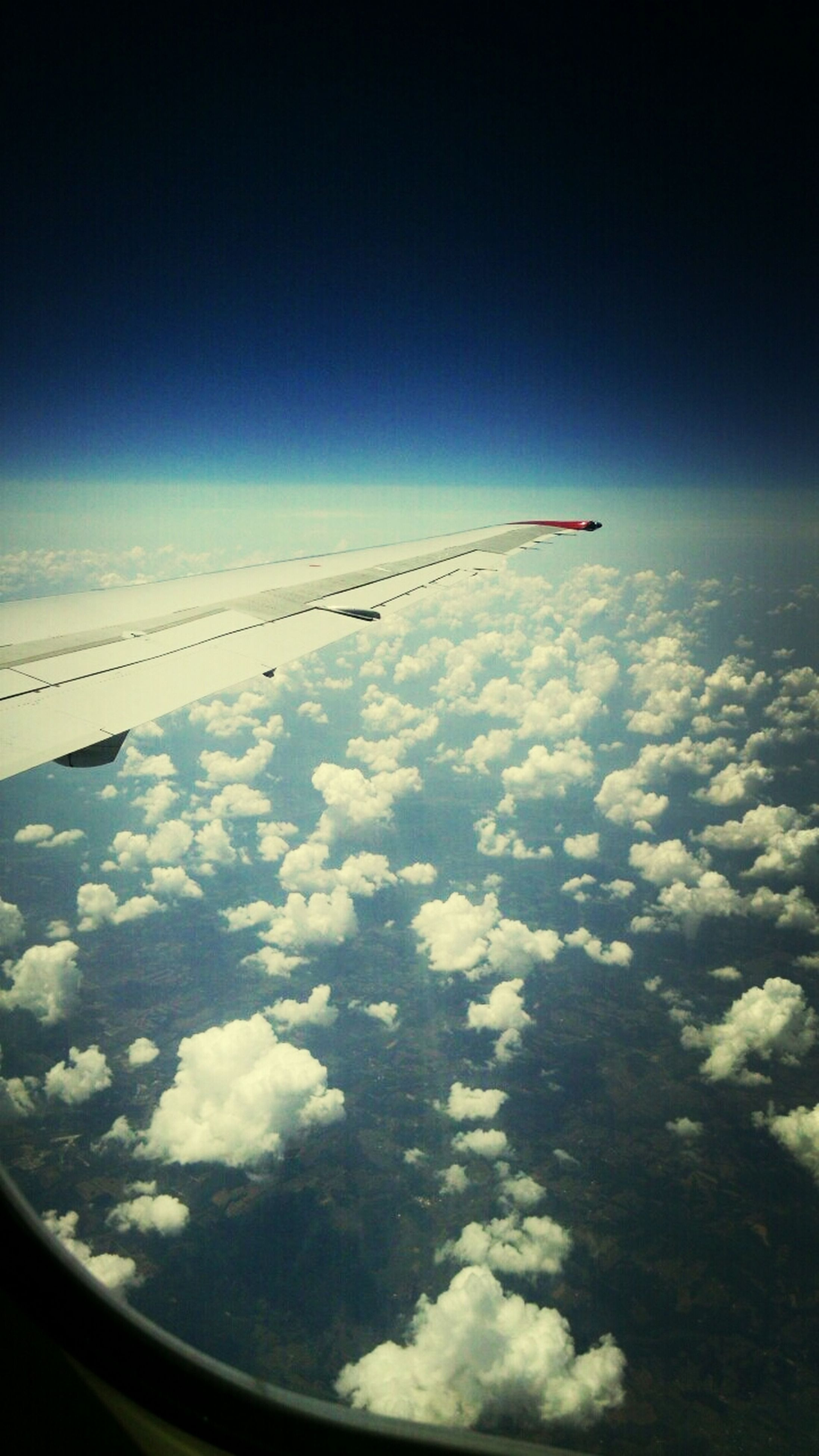 transportation, airplane, flying, mode of transport, air vehicle, aircraft wing, mid-air, sky, part of, aerial view, travel, cropped, on the move, journey, cloud - sky, scenics, public transportation, vehicle interior, nature, beauty in nature