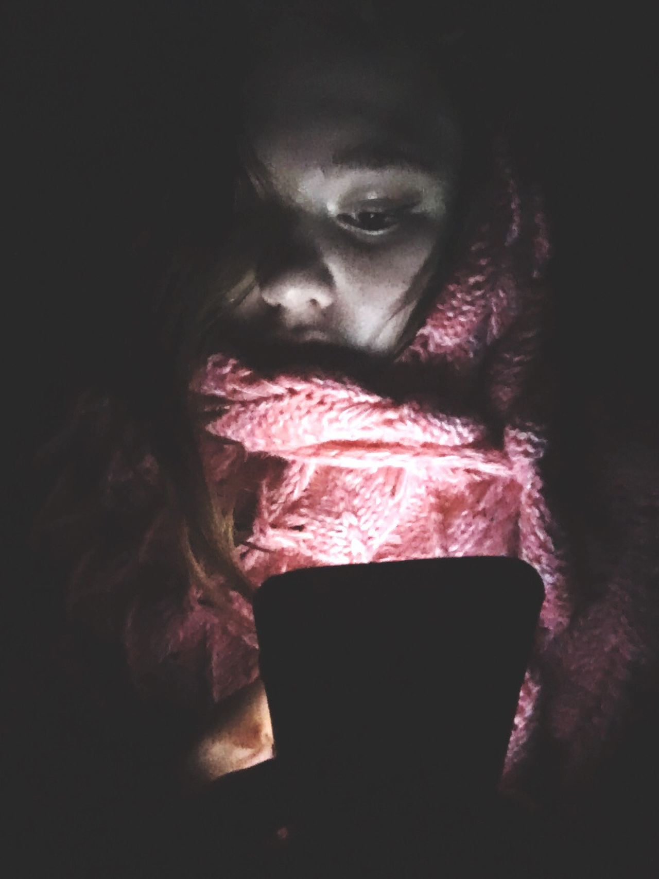 Dark Lifestyles Wireless Technology Technology One Person Real People Indoors  Portrait Close-up Night Young Women Young Adult People Adult Light Blanket Comfortable Shadow And Light Lights Pink Girl One Woman One Young Woman Only Young Girl Darkness