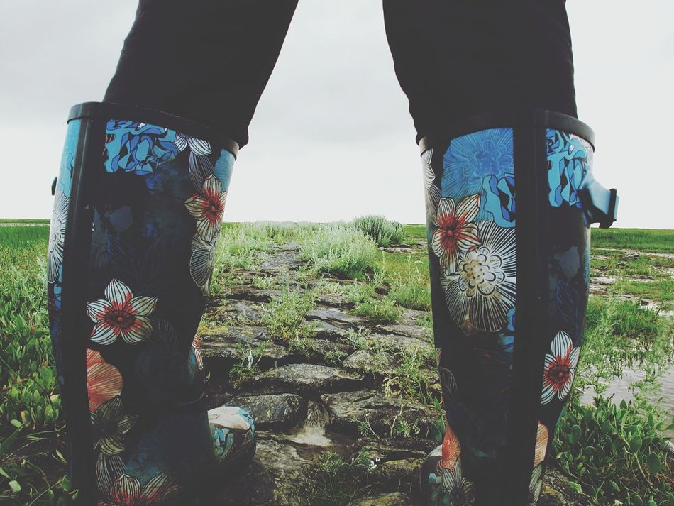 With no end in sight.. Salt Marshes Northsea Vast Vastness Seaside Grassland Rubber Boots Legs Landscape Landscape_Collection Relaxing Tranquility Flower Pattern Path In Nature Path Feel The Journey Walking Nature_collection EyeEm Nature Lover Canon Simplicity Still Life Wellies  Showcase July People Together Breathing Space