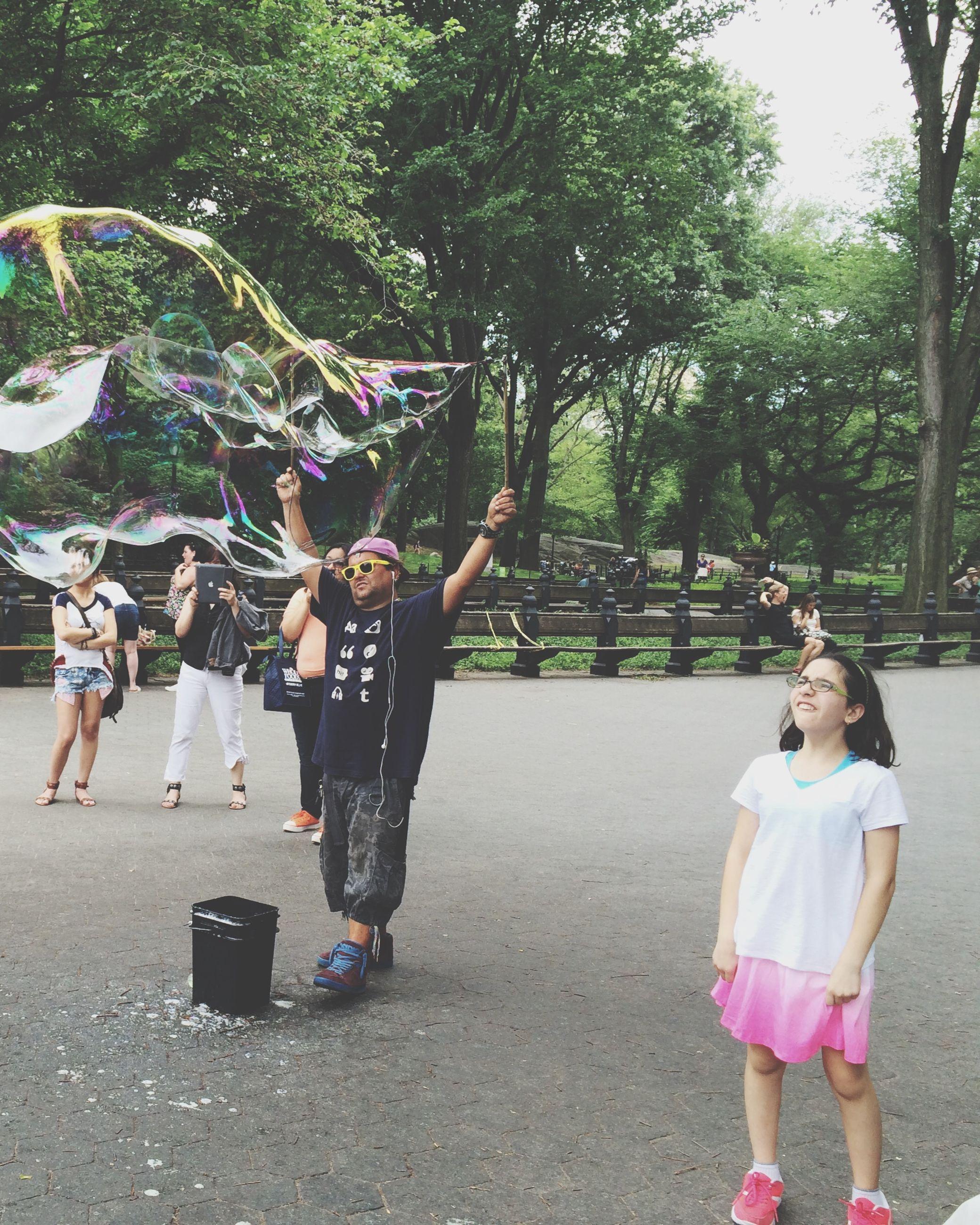 lifestyles, casual clothing, leisure activity, childhood, tree, full length, girls, elementary age, boys, person, park - man made space, enjoyment, fun, togetherness, day, playing, standing