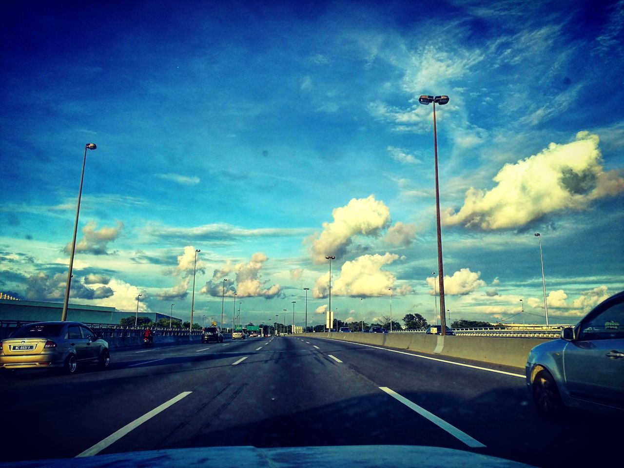 car, transportation, road, cloud - sky, sky, land vehicle, mode of transport, windshield, day, the way forward, car interior, car point of view, no people, blue, outdoors, nature