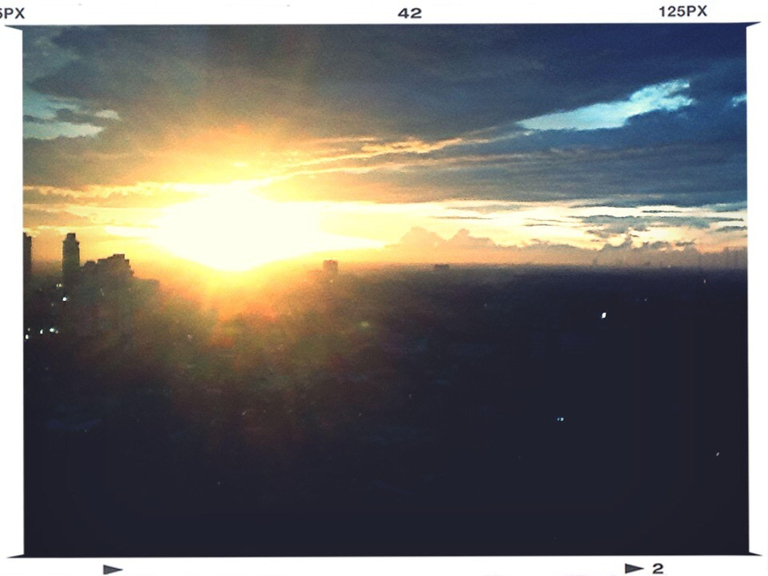 transfer print, sunset, sun, auto post production filter, silhouette, sky, sunlight, cloud - sky, sunbeam, building exterior, orange color, beauty in nature, lens flare, nature, scenics, outdoors, tranquility, built structure, cloud, architecture