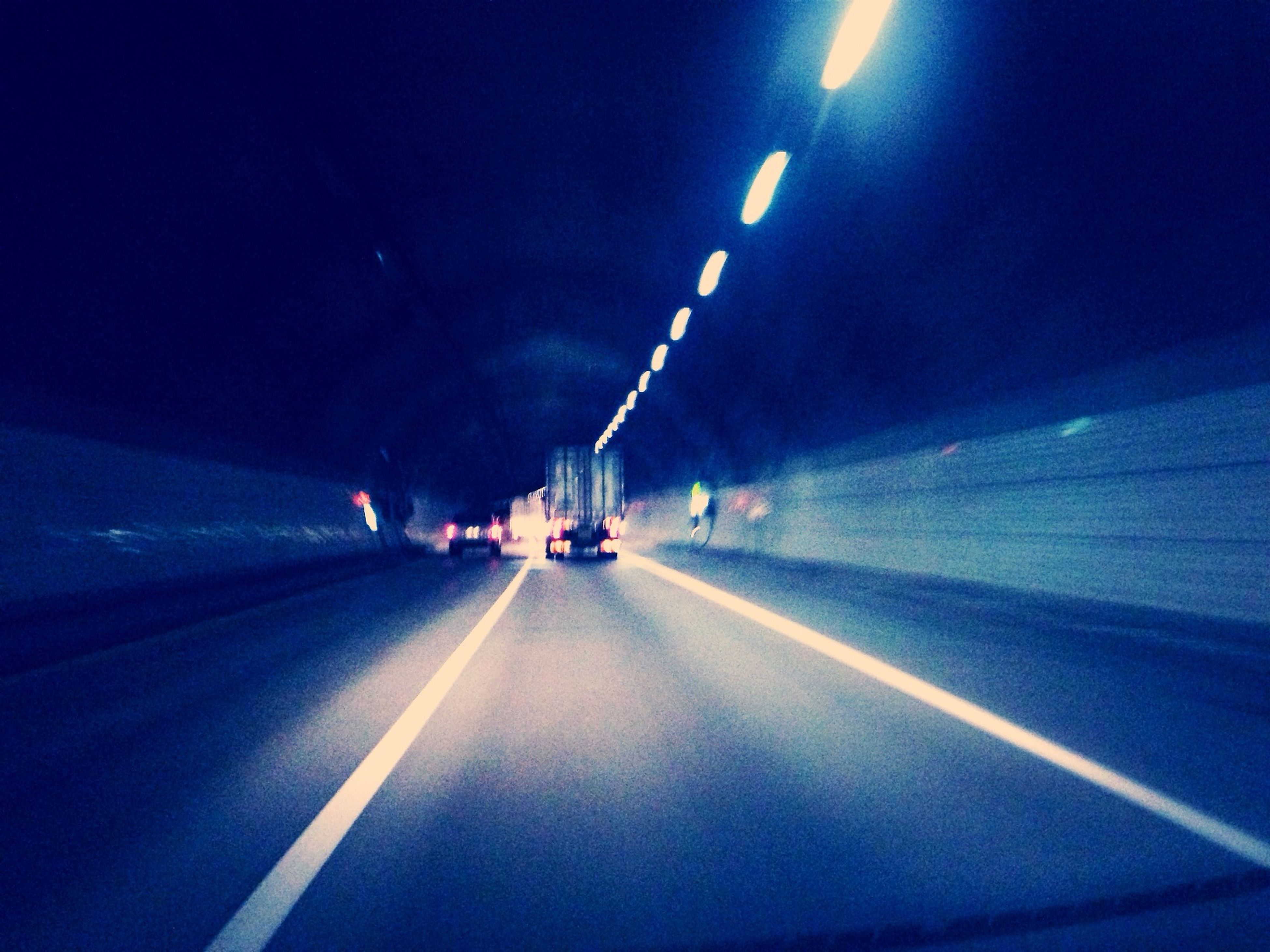 transportation, illuminated, the way forward, diminishing perspective, mode of transport, road, road marking, vanishing point, night, travel, on the move, lighting equipment, blue, indoors, tunnel, land vehicle, car, speed, journey, highway