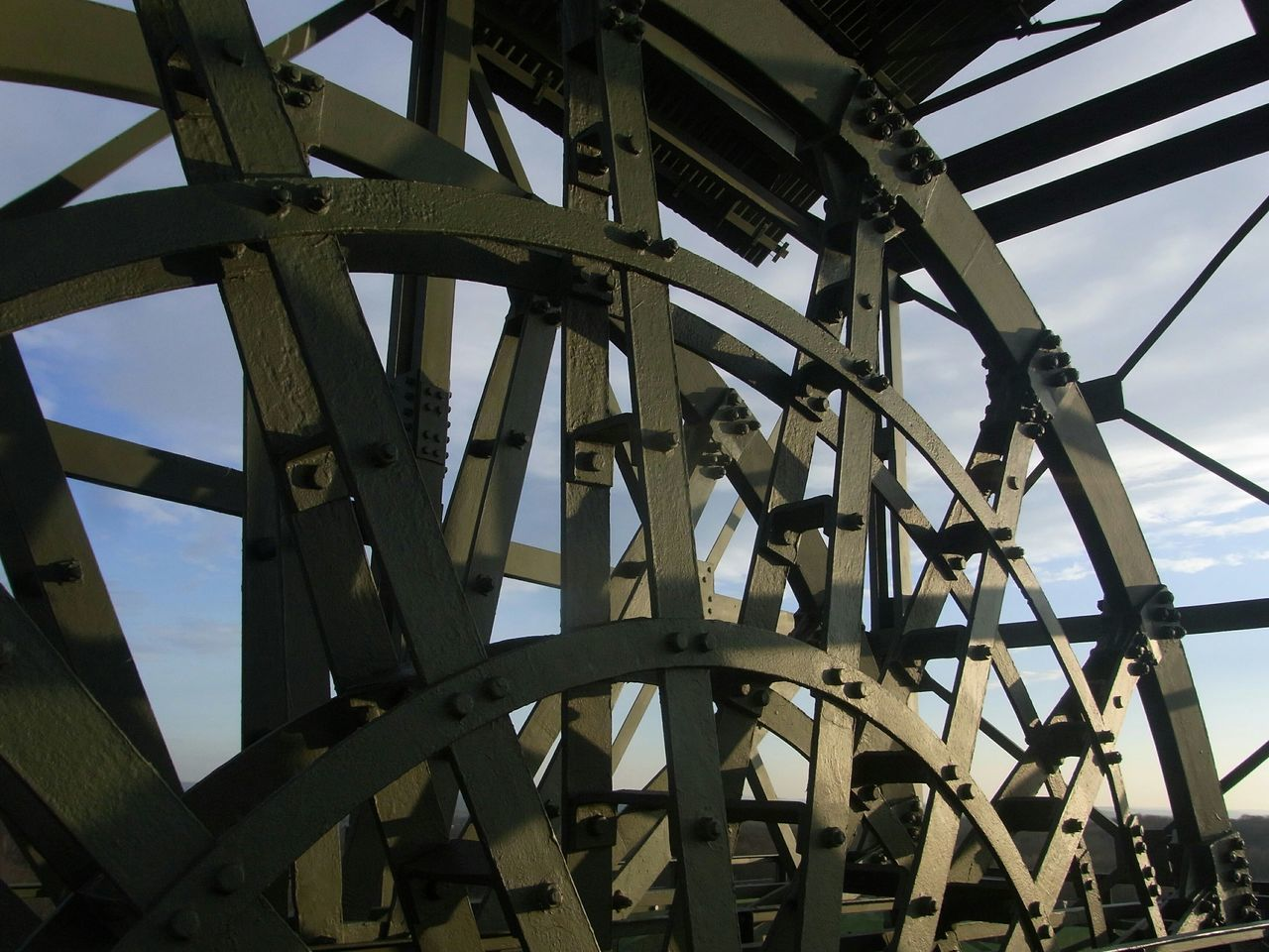 water wheel, watermill, low angle view, outdoors, day, no people, sky, architecture, close-up