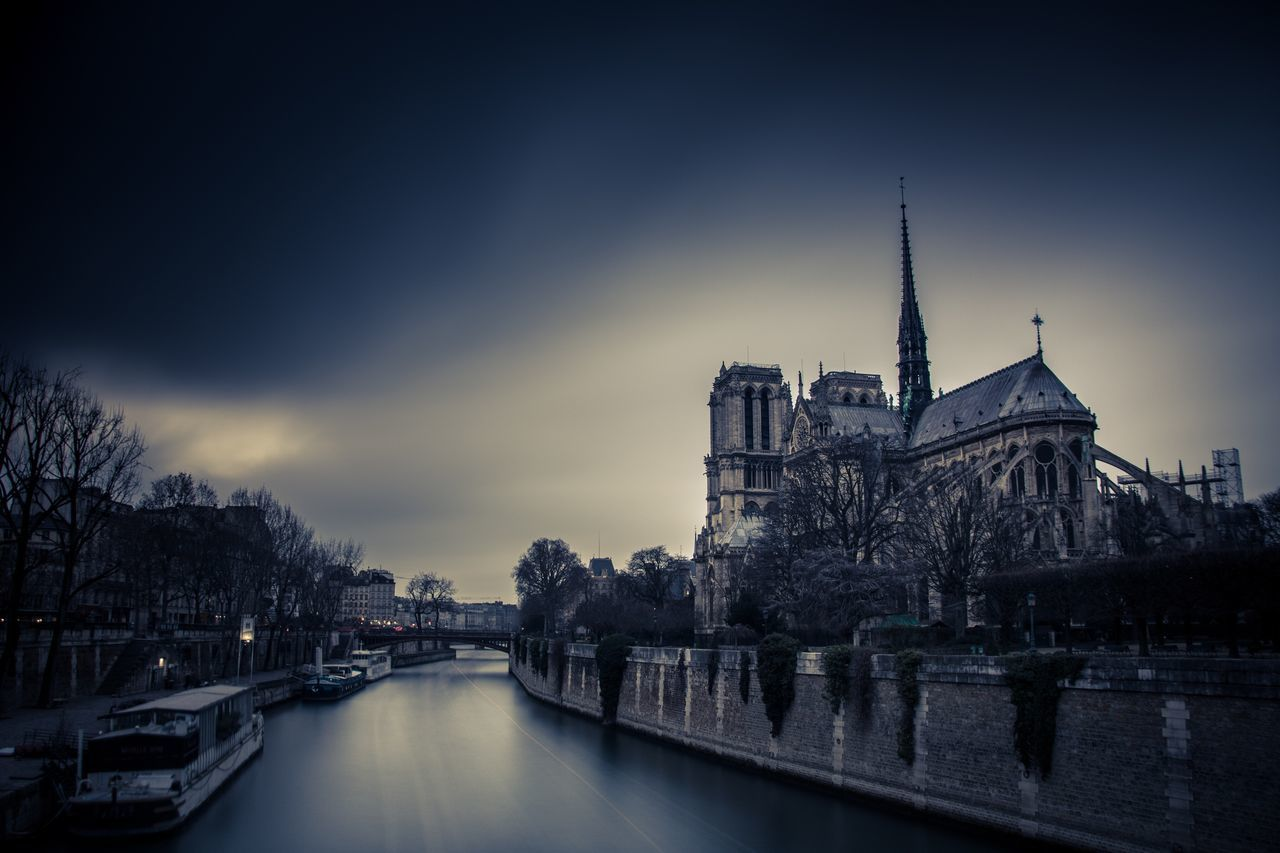 Long exposure with a filter ND1000 next to Notre-Dame Architecture Built Structure Building Exterior Sky Water River No People City Travel Destinations Waterfront Cloud - Sky Outdoors Religion Illuminated Place Of Worship Bridge - Man Made Structure Tree Cityscape Day