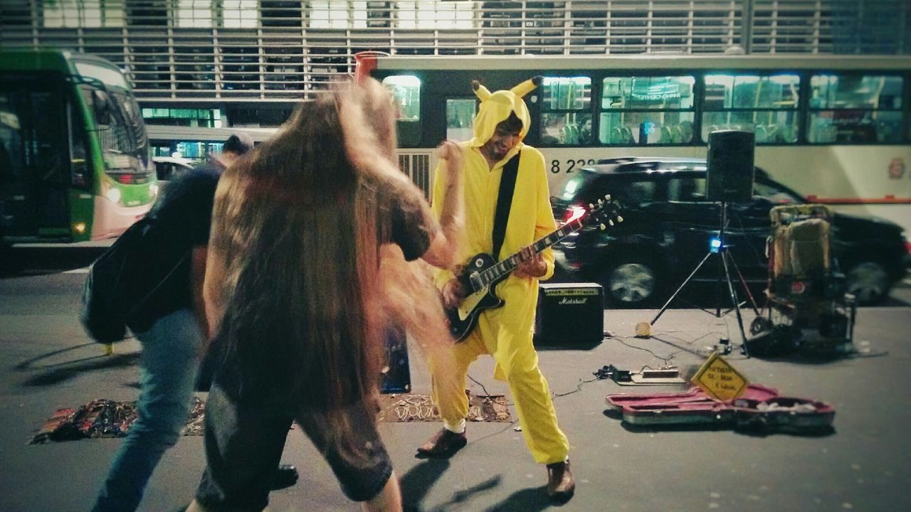 Street Art Streetphotography Street Art Guitar Rock N Roll Headbangers Pokemon Go Pikachu Costume Entertainment Happiness Fun Friends Longhair Gibson Les Paul Enjoy The New Normal Brazil Metal Night Outdoors Musician