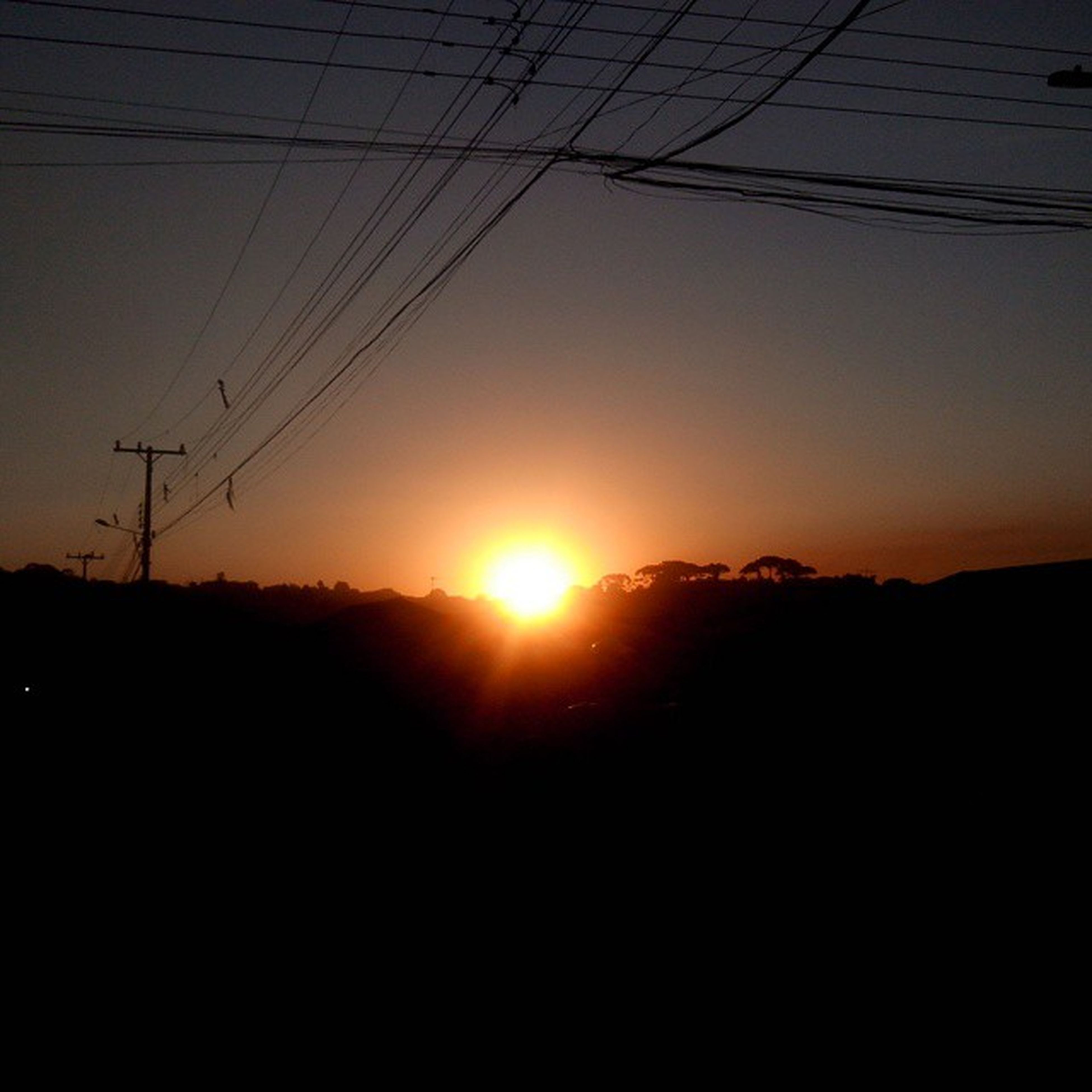 sunset, silhouette, sun, power line, electricity pylon, scenics, tranquil scene, tranquility, power supply, electricity, beauty in nature, sky, cable, orange color, nature, landscape, sunlight, connection, idyllic, dark