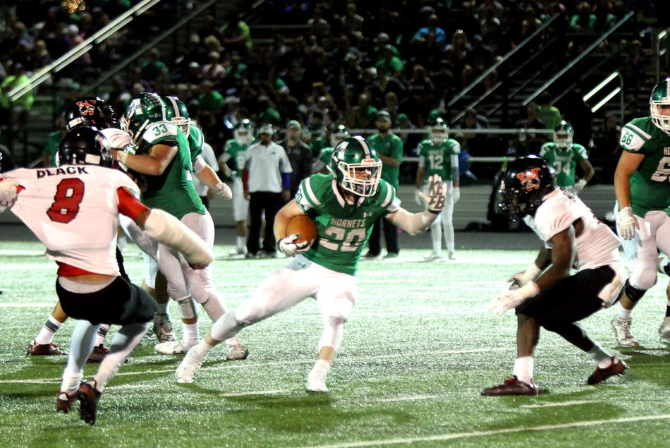 Senior runs the ball and avoids a tackle Football Football Stadium Green And White High School High School Football High School Sports Hornet Pride Hornets Pride Rule Of Thirds Running School Spirit Sport Tackle