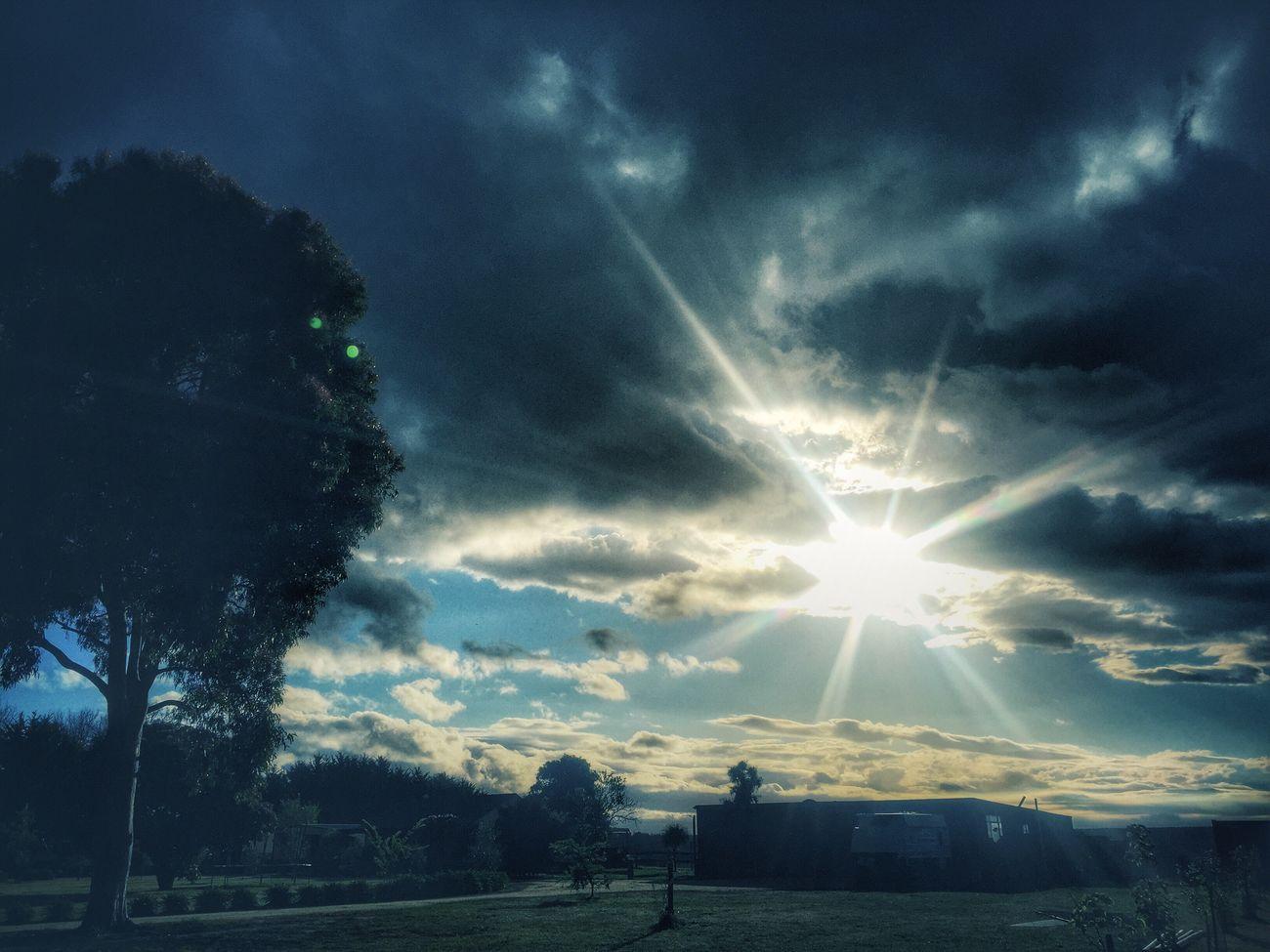 Home sweet home Sky Sunbeam Lens Flare Sunlight Tree Cloud - Sky Nature Landscape Tranquil Scene Outdoors Sunset Beauty In Nature Sunset #sun #clouds #skylovers #sky #nature #beautifulinnature #naturalbeauty #photography #landscape Rural Scene EyeEm Best Edits Non-urban Scene Australian Landscape Iphoneonly Australia