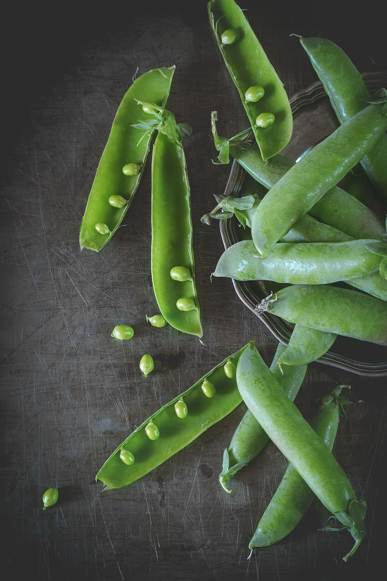 Heap of young green peas whole and broken over old metal surface. Rustic style. Natural day light. Top view Country Dark OpenEdit Rustic Sweet Pea Day Light Food Food And Drink Fresh Green Color Green Pea Healthy Eating Ingredient Metal Space For Text Top View Vegetable