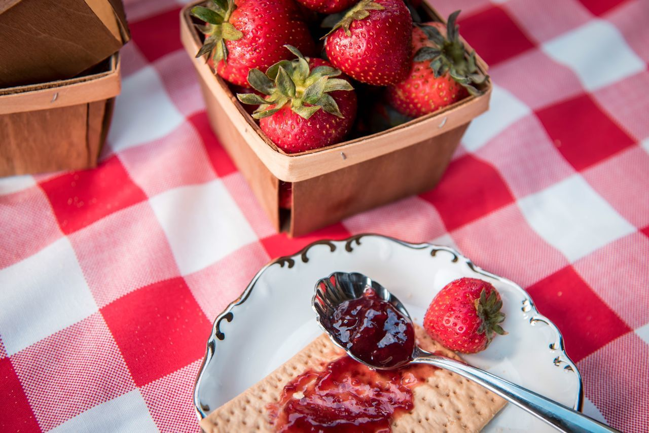 High Angle View Of Strawberries And Cracker And Jam On Table