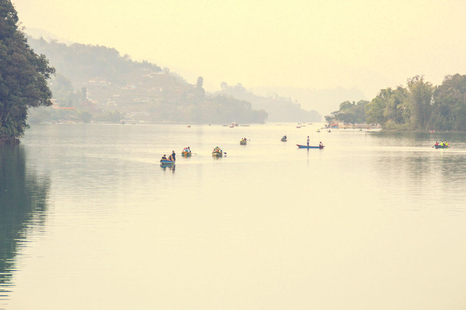 Minimalism Copy Space Tranquil Scene Lake Water Phewa Lake Pokhara! Outdoors Nature Vacations People Beauty In Nature Pedal Boat Nautical Vessel Togetherness Adventure Travel Travel Photography Placid Lake