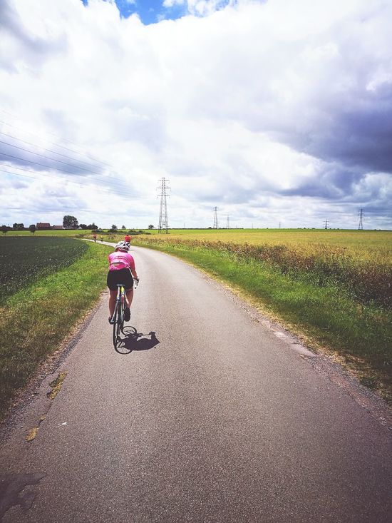 Cycle Race Cycling Cloud - Sky Road Rural Scene Bicycle One Person Transportation Full Length Day One Man Only Headwear People Adult Landscape Riding Outdoors Sky Nature
