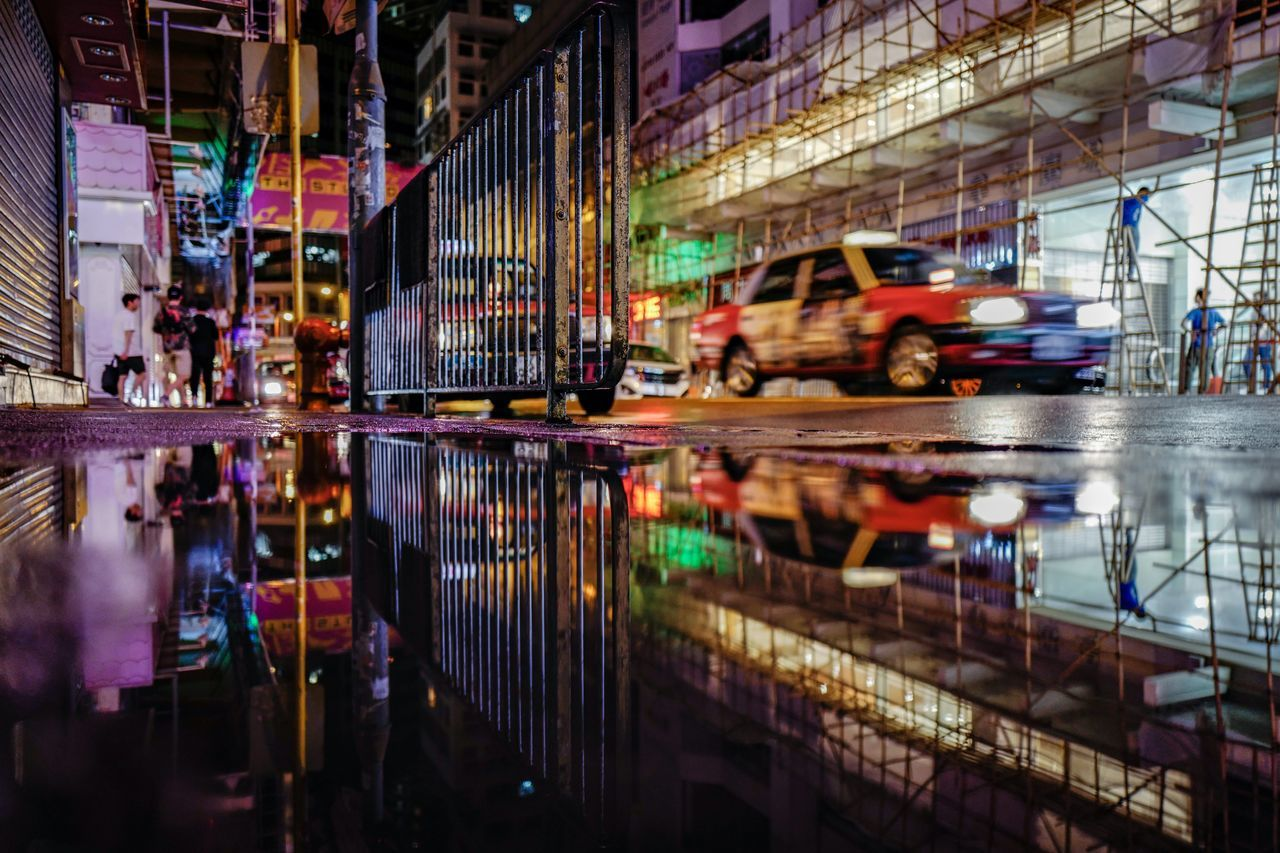 puddle at TST EyeEmNewHere Discoverhongkong Architecture Reflection Mystyle Puddle Art Is Everywhere Shadows & Lights Beautiful Nightshooters From My Point Of View City Life Cityscape Streetphotography EyeEm Selects Outdoors Taxi Transportation Reflection