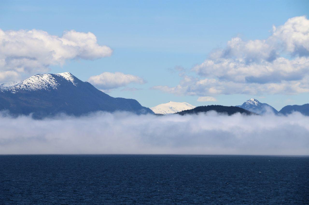 Fog bank in Alaska Fog Bank Alaska Beauty In Nature Cloud - Sky Day Fog Fog Over Water Idyllic Mountain Mountain Range Nature No People Outdoors Scenics Sea Sky Tranquil Scene Tranquility Water