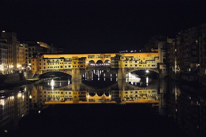 Ponte Vecchio at night reflected on the river Arno. Florence, Italy Water Reflections Night Lights Starry Night Golden Hour Ponte Vecchio Travel Photography Bridge EyeEm Best Shots Florence Wanderlust