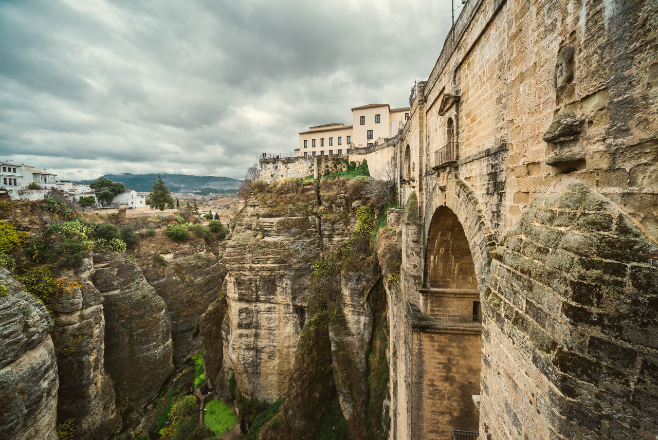 Bridge and Picturesque view of Ronda city. Province of Malaga, Andalusia, Spain Ancient Architecture Andalusia Bridge Bridge - Man Made Structure Cliffs Cloud - Sky Costa Del Sol Famous Place Hillside History Houses Landmark Landscape Malaga Mountain Nature Outdoors Picturesque Village Rocky Mountains Ronda Spain Scenery SPAIN Town Travel Destinations Village