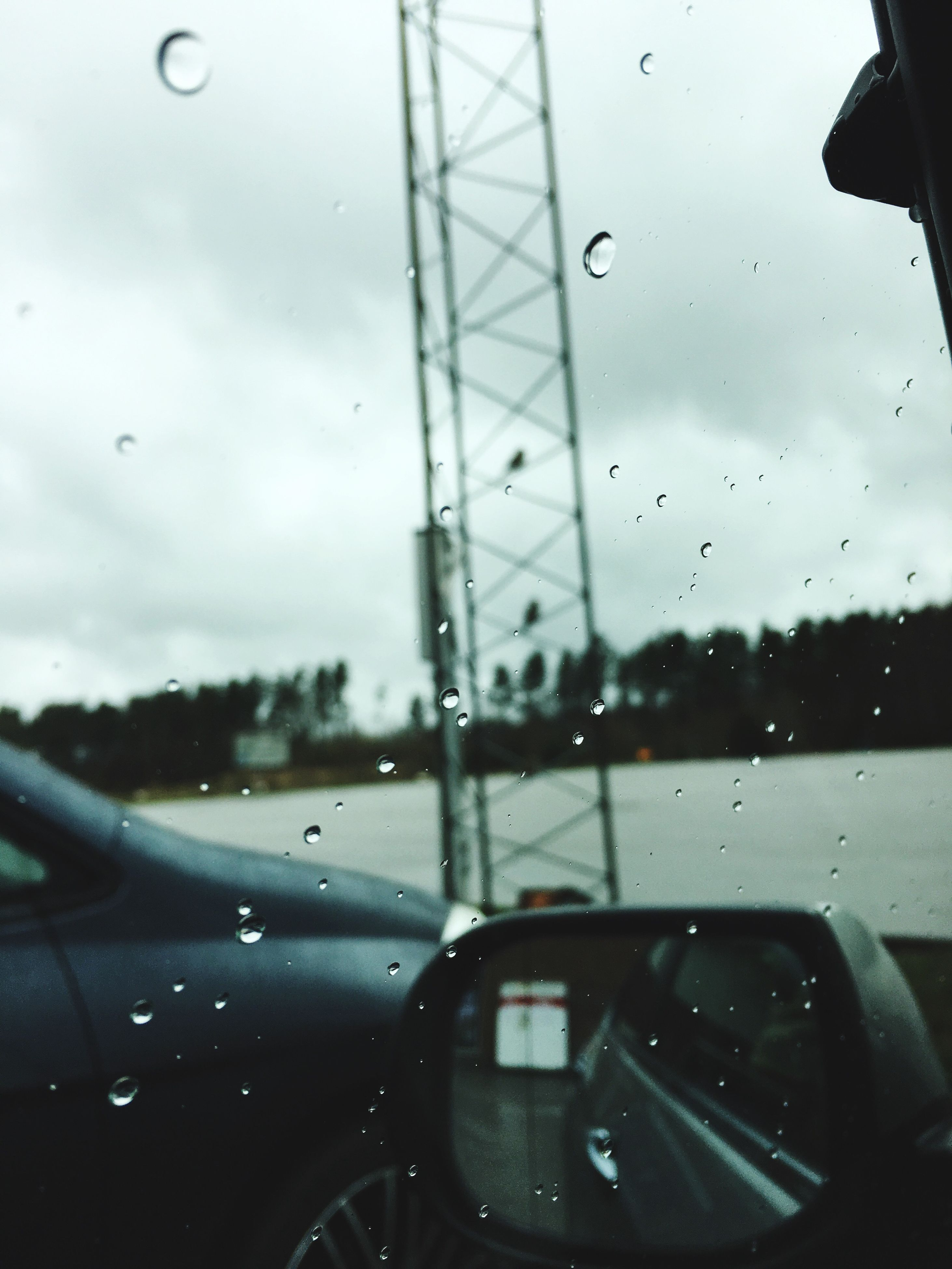 wet, rain, transparent, glass - material, transportation, car, vehicle interior, drop, car interior, windshield, water, weather, mode of transport, sky, land vehicle, close-up, window, rainy season, no people, day, dashboard, nature, windscreen, tree, indoors, vehicle mirror