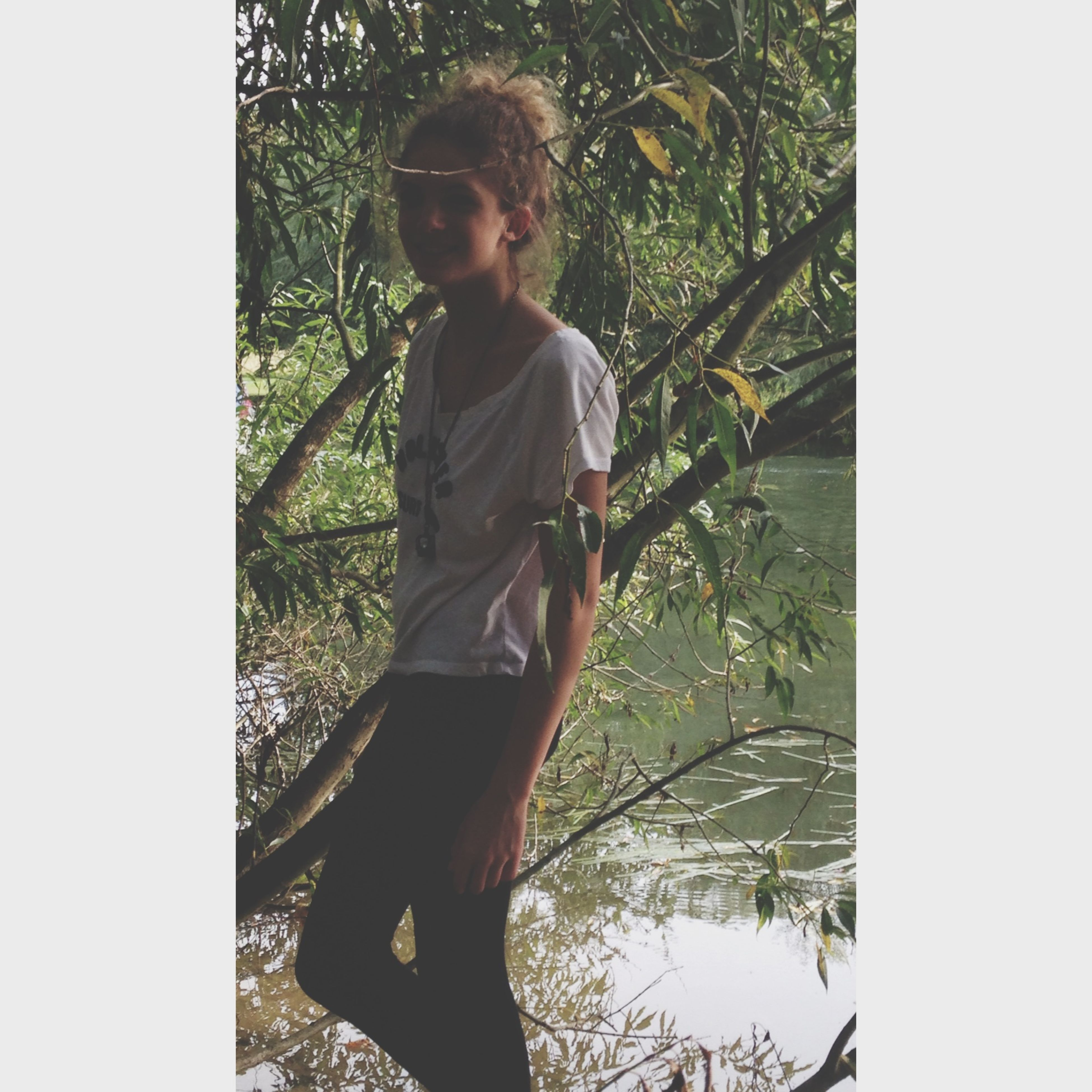 transfer print, tree, lifestyles, young adult, leisure activity, auto post production filter, person, standing, casual clothing, looking at camera, full length, portrait, front view, three quarter length, young women, branch, nature, day