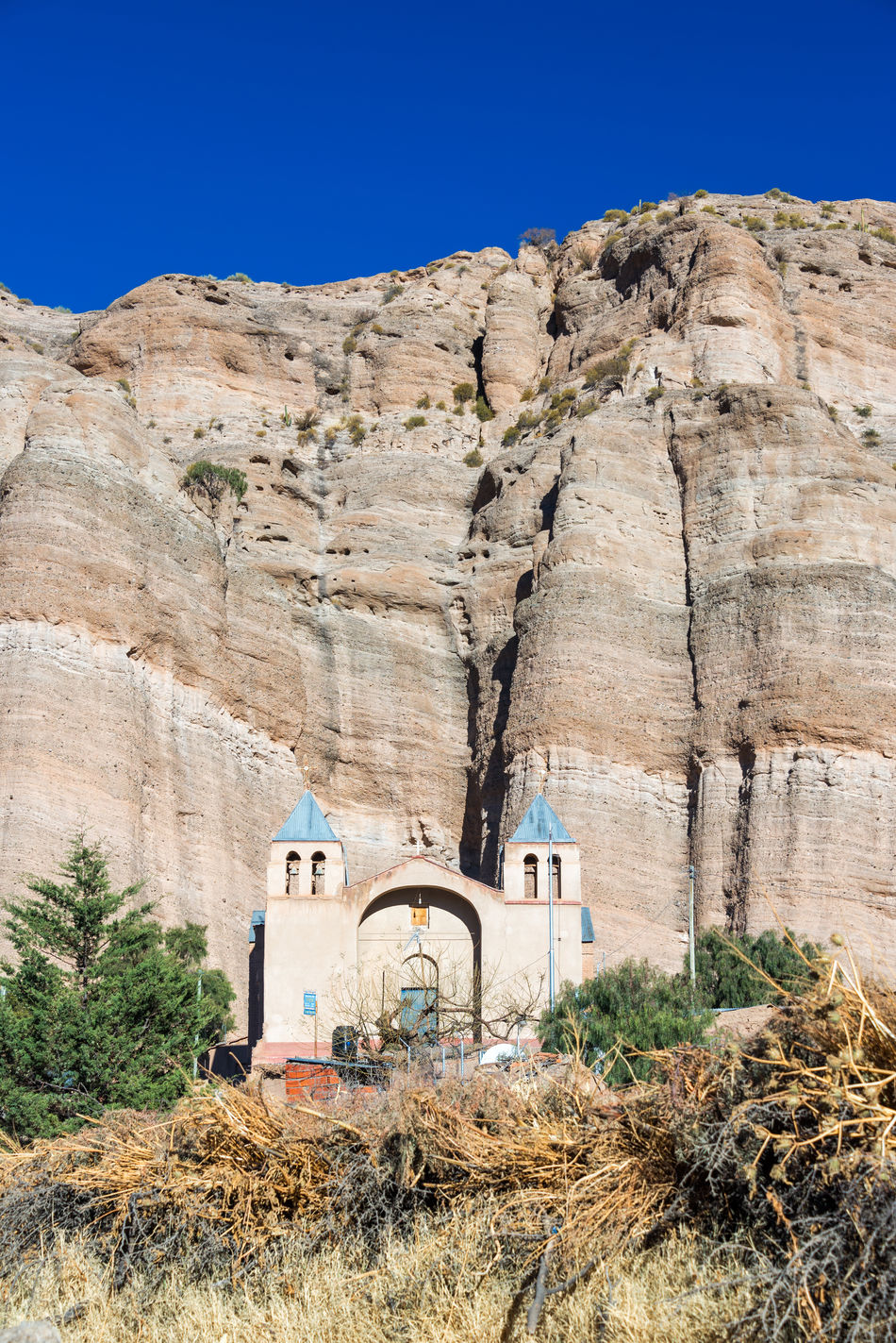 Church set against a dramatic cliff in the small town of Espicaya near Tupiza, Bolivia Amazing Andes Beauty Bolivia Cactus Canyon Church Color Countryside Desert Destination Formation Formations High Hills Landscape Mountain Nature Rock Rocks South America Traditional Travel TUPIZA Valley