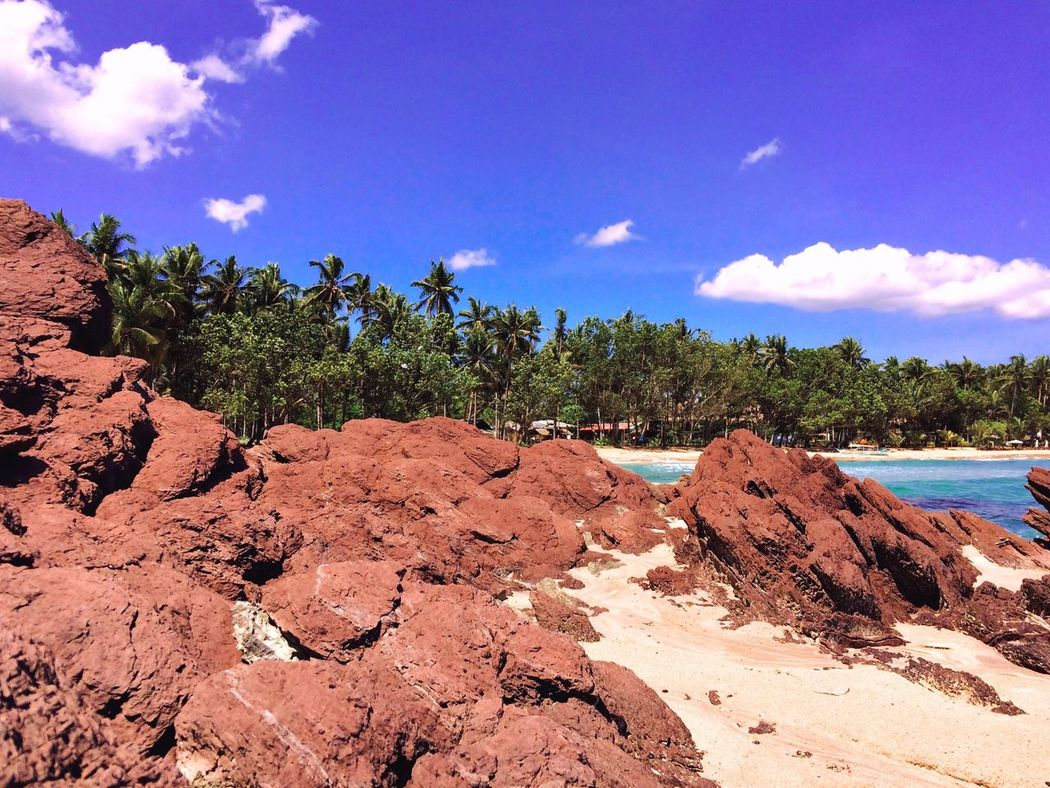 Rockformation Rocks And Water Red Rocks  Seaside Sea Sea And Sky Mothernature Nature_collection Nature Photography Mountain Green Trees And Sky Sabang Itsmorefuninthephilippines Travel Photography