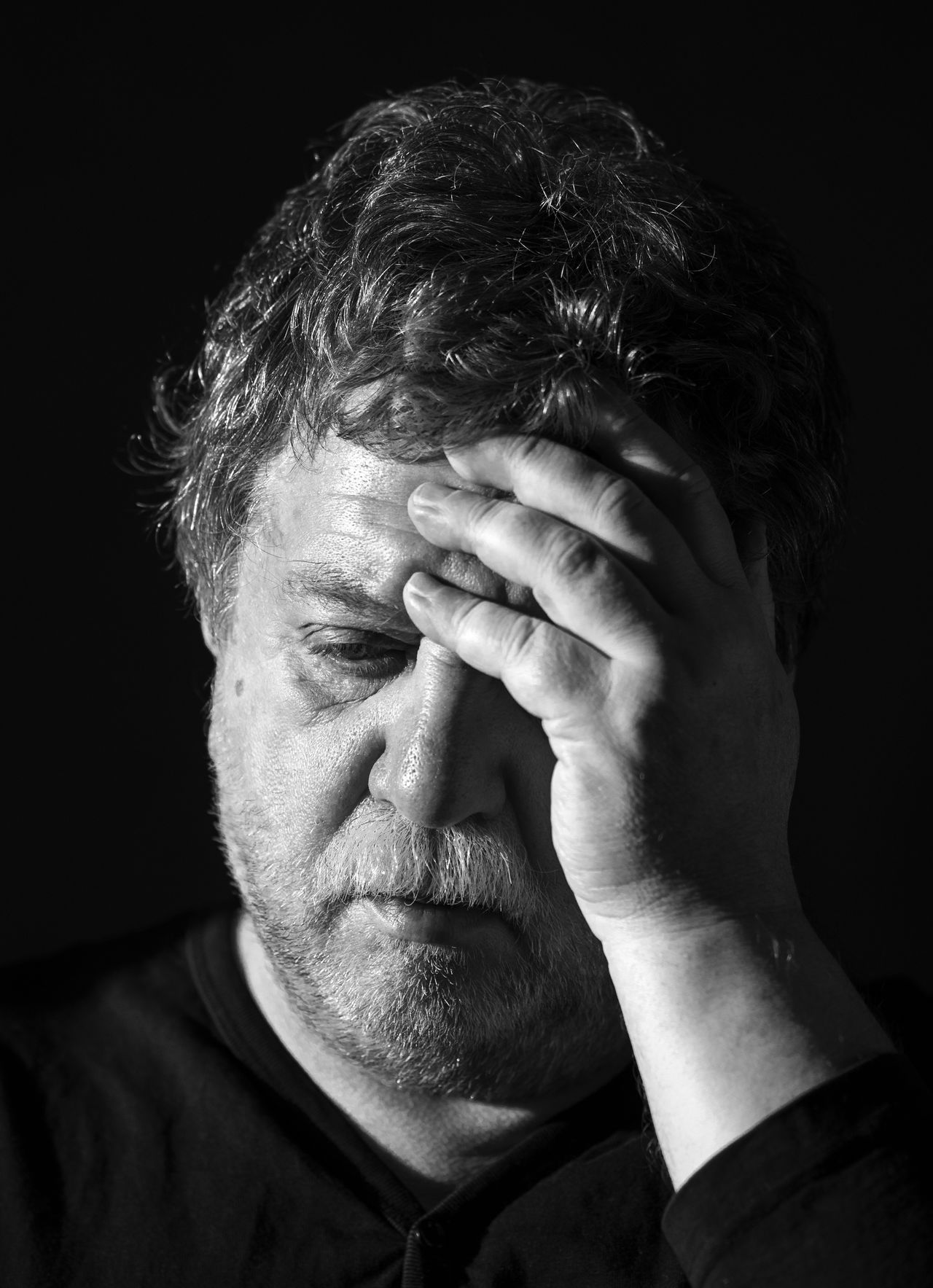Black and white portrait of Middle aged sad caucasian man with beard and mustache Adult Aged Beard Black And White Black Background Caucasian Close-up Day Depression - Sadness Headshot Human Body Part Human Face Human Hand Indoors  Men Middle Mustache One Man Only One Person Only Men Portrait Real People Sad Studio Shot Tensed