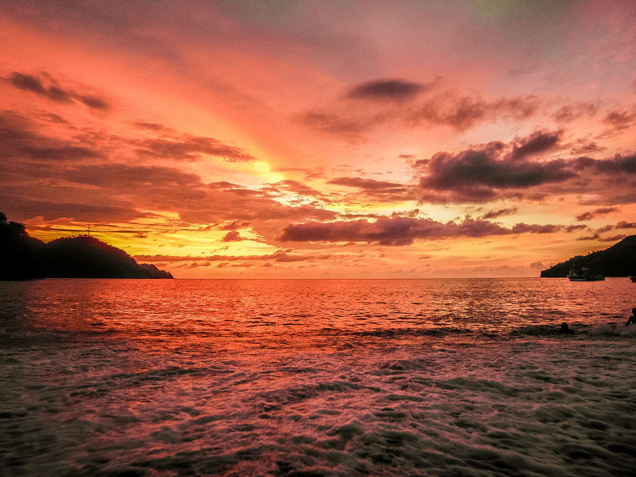 Colorful sunset at the beach Beach Beauty In Nature Clouds Dramatic Sky Foam Idyllic Nature Outdoors Red Reflection Scenics Sea Sunset Tranquil Scene Tranquility Water