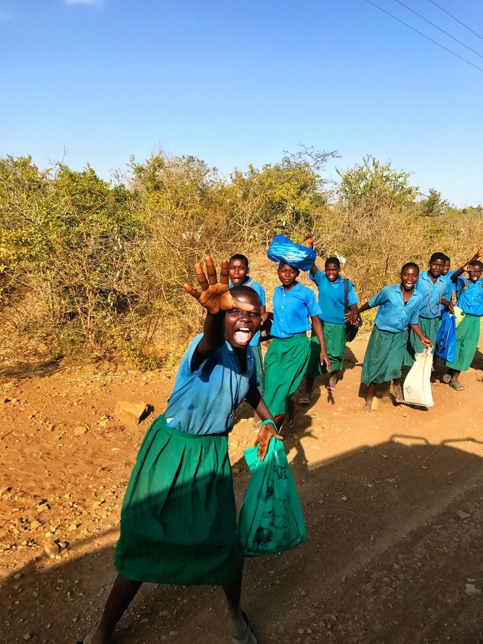 Kenya Africa Road Roadtrip Childhood Happy Happy Children Schoolchildren Blue Leisure Activity Real People Looking At Camera Outdoors Lifestyles Friendship Cheerful African Beauty African Child African Children