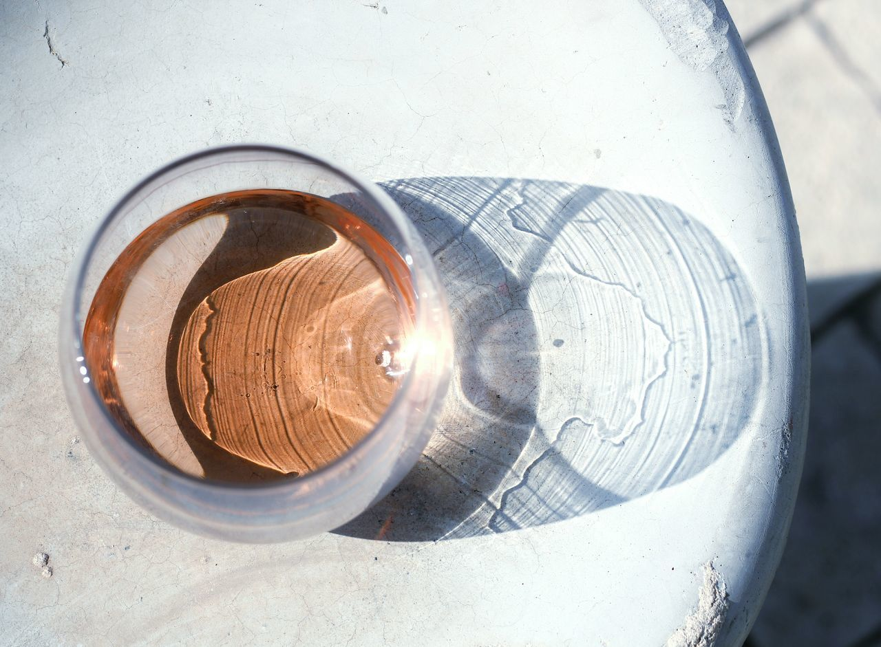 Directly Above Shot Of Reflection In Wineglass On Table