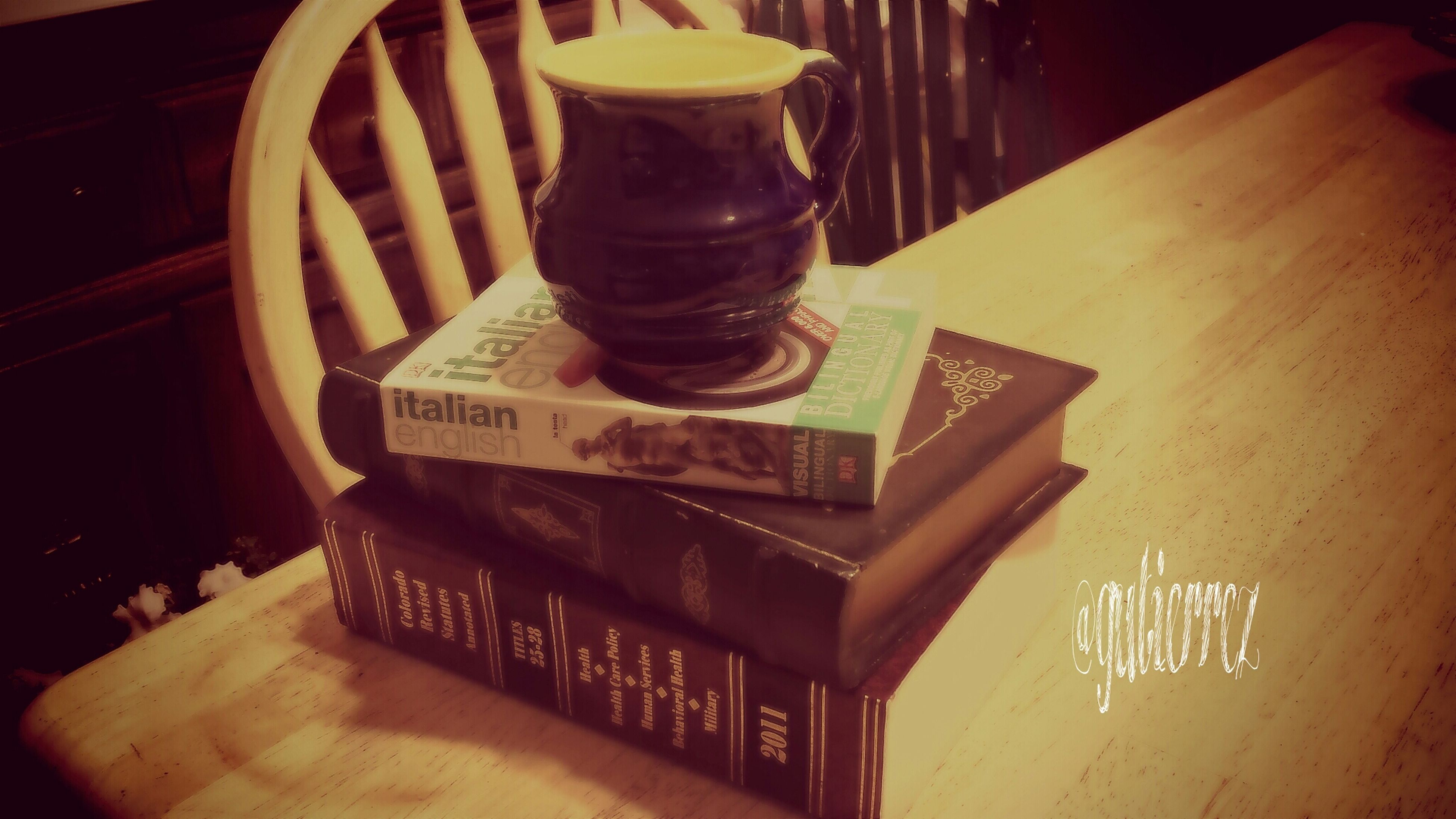 indoors, text, table, western script, communication, wood - material, still life, high angle view, no people, food and drink, non-western script, close-up, book, low angle view, restaurant, paper, architecture, built structure, day, shelf