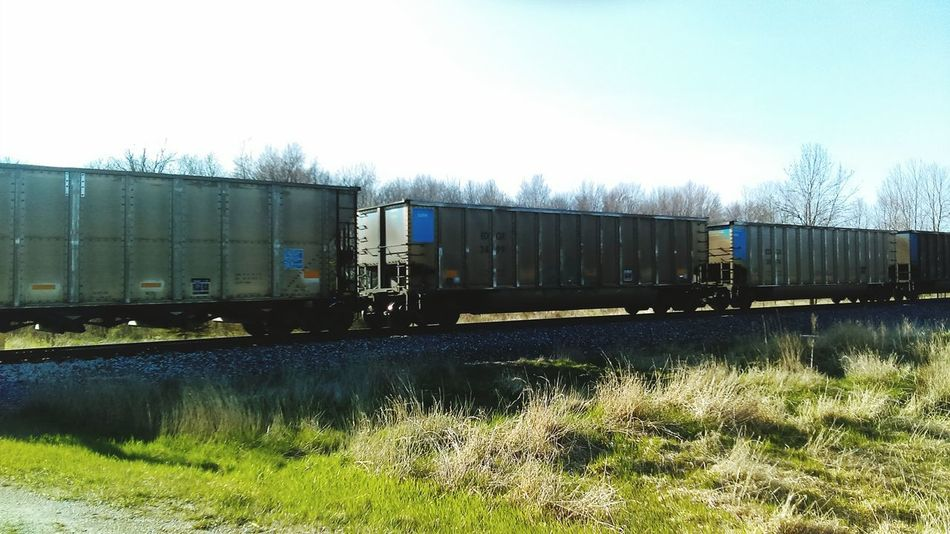 Train - Vehicle Transportation Mode Of Transport Rail Transportation Freight Transportation Railroad Track No People Day Grass Outdoors Sky Locomotive