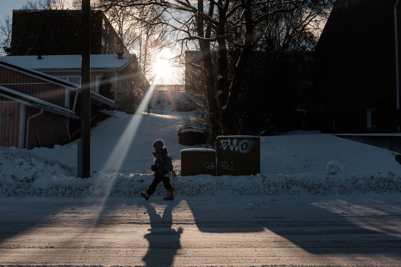 walking home in the beatuiful winter day Child Walking Kid On The Way Home Walking Walking To School  Way Home Way Home From School Winter Sun Wintertime Young