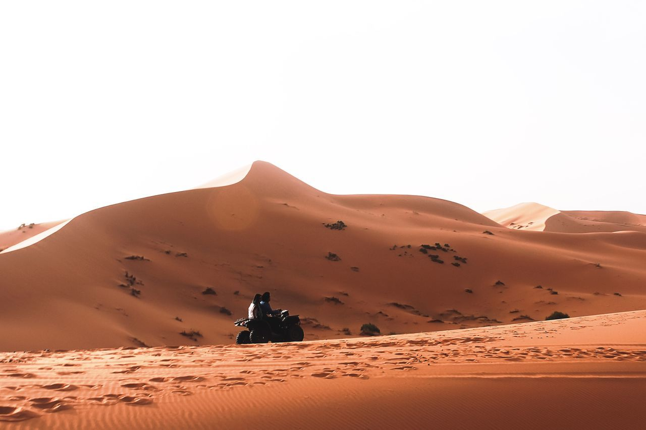 Desert Sand Dune Sand Arid Climate Travel Outdoors Nature Landscape Extreme Terrain Clear Sky One Person Adventure Mountain Scenics Day Adults Only Morocco Erg Chebbi Maroc People Sky Adult